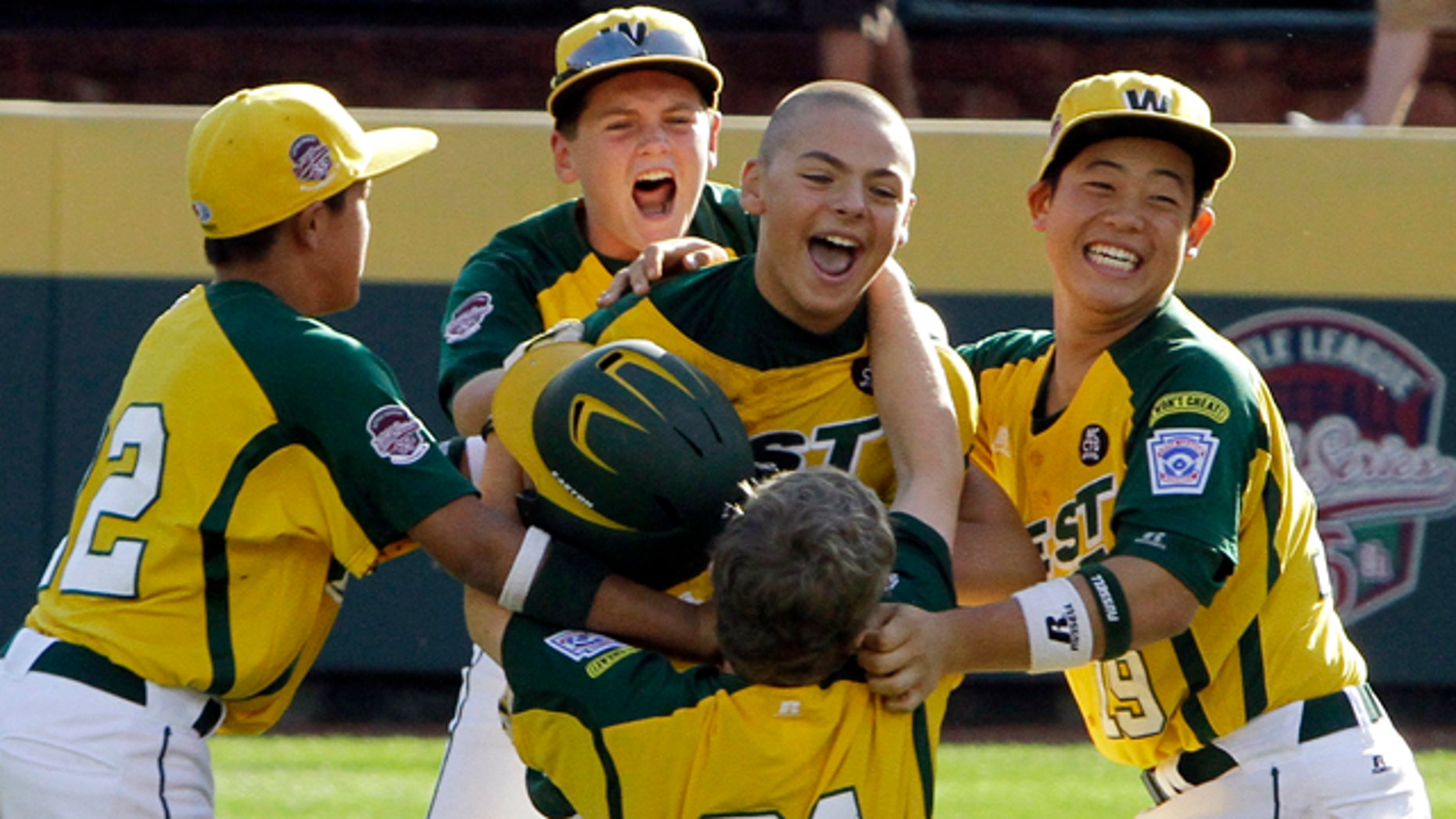 Aug. 28: Huntington Beach, Calif.'s Nick Pratto, center, celebrates with teammates after driving in the winning run with a walk-off single off Hamamatsu City, Japan, pitcher Kazuto Takakura to win the Little League World Series Championship baseball game in South Williamsport, Pa. California won 2-1.