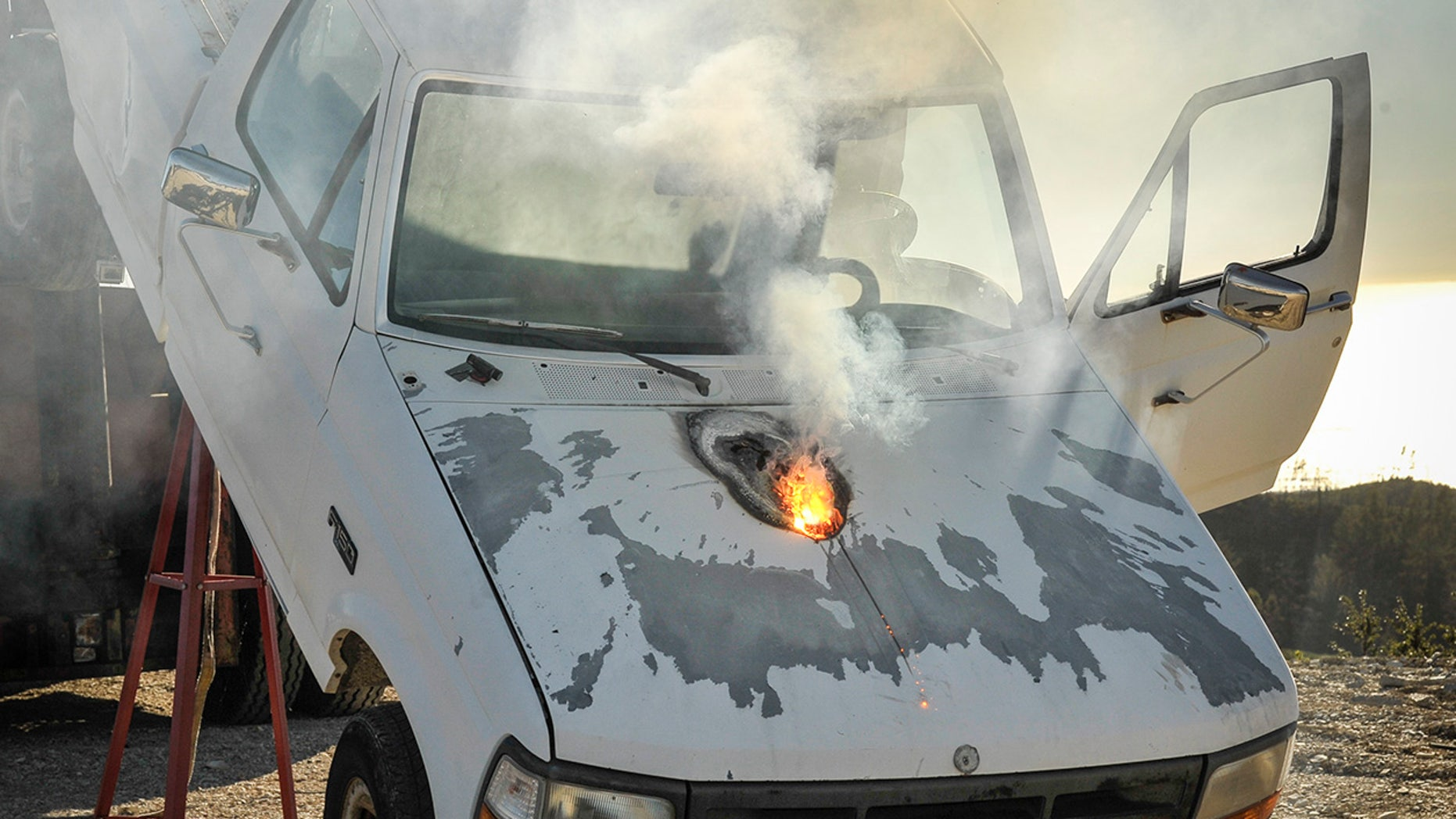 Lockheed Martin ATHENA laser weapon system defeats a truck target by disabling the engine, demonstrating its military effectiveness against enemy ground vehicles.