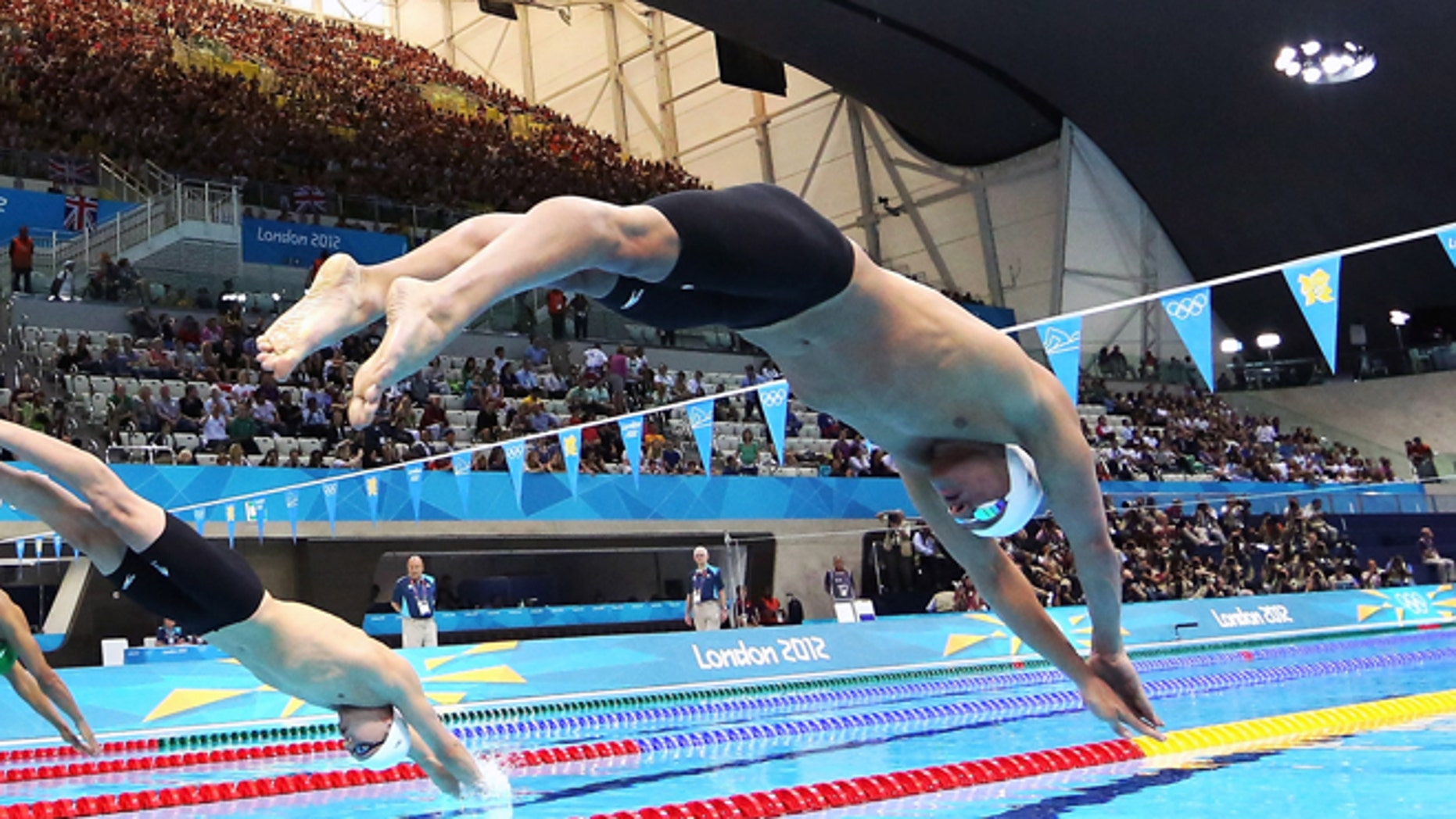 July 28, 2012: United States swimmer Ryan Lochte dives off of the starting block during the men's 400-meter individual medley event during the 2012 Summer Olympics at the Aquatics Centre in London.