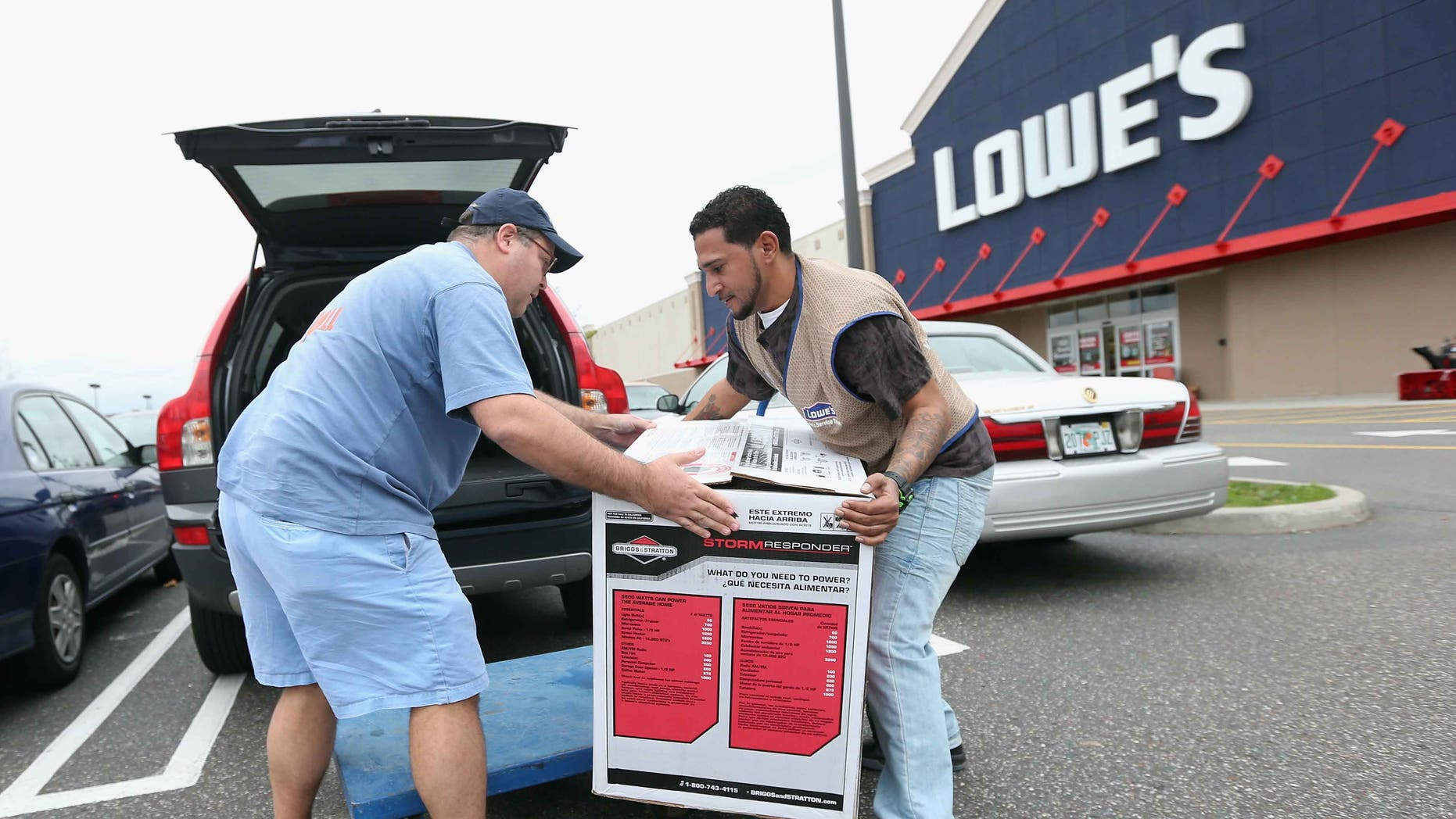 HICKSVILLE, NY - OCTOBER 28:  Joseph Klein of Sayville, New York is assisted by Lowe's employee Ormani Rivera after his purchase of a generator as Hurrican Sandy approaches on October 28, 2012 in Hicksville, New York. Sandy, which has already claimed over 50 lives in the Caribbean is predicted to bring heavy winds and floodwaters to the mid-atlantic region.  (Photo by Bruce Bennett/Getty Images)