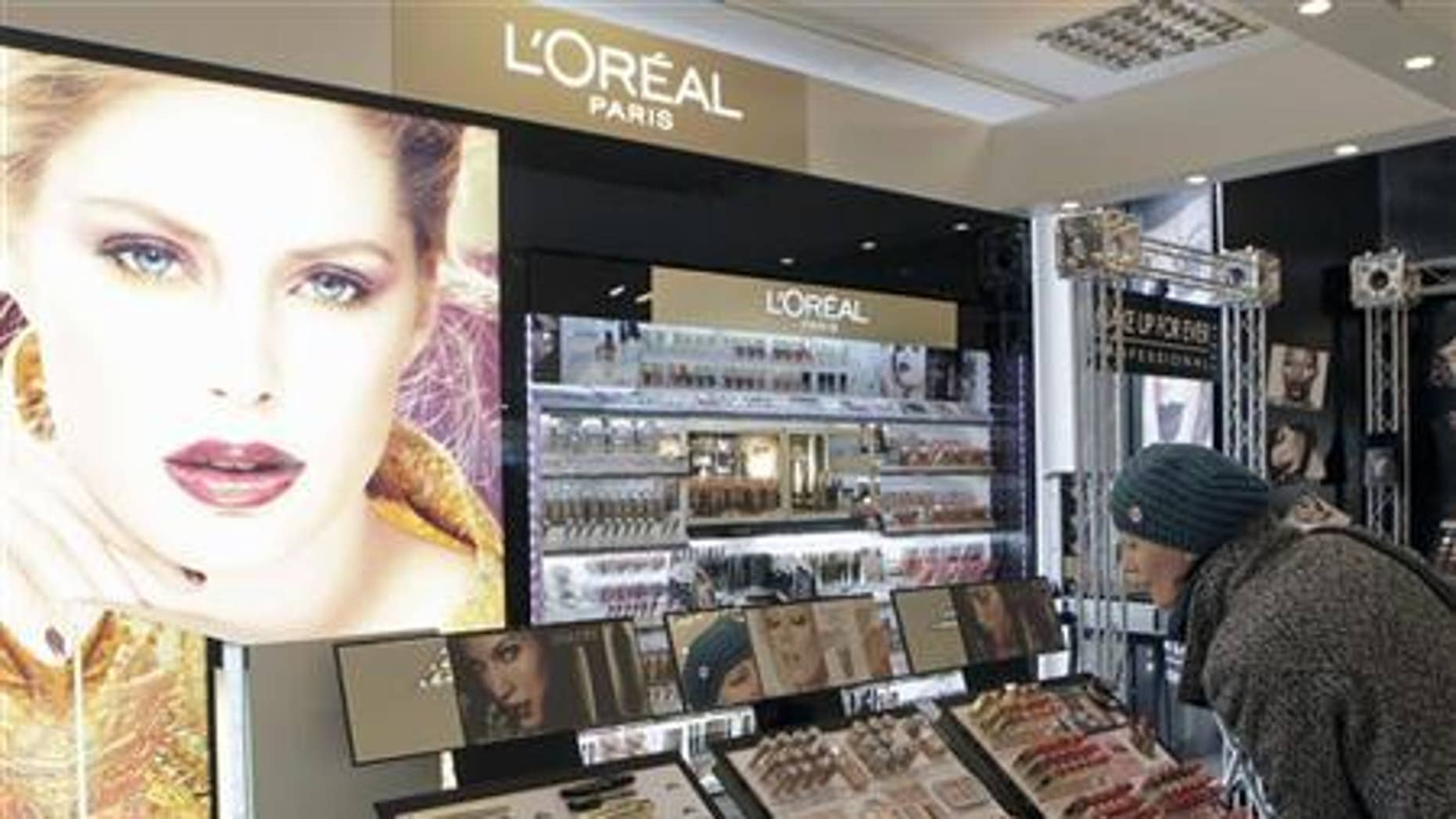 A woman looks at L'Oreal cosmetics in the shop in Riga April 13, 2012. REUTERS/Ints Kalnins