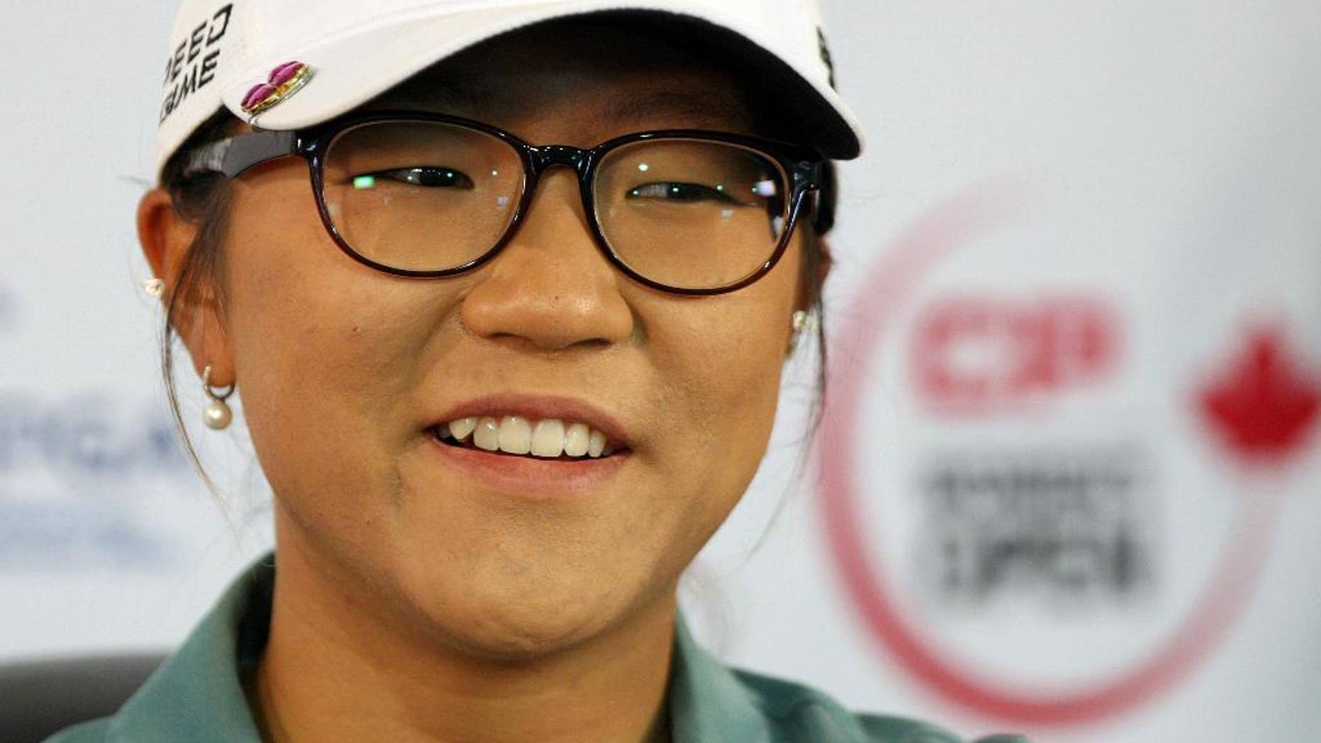 FILE - This is an Aug. 20, 2014, file photo showing Lydia Ko answering questions at the Canadian Pacific Women's Open golf tournament in London, Ontario. Ko has become the youngest player to win the LPGA Tour's rookie of the year award. The 17-year-old Ko clinched the points-based award with three tournaments remaining on the LPGA Tour schedule.  (AP Photo/The Canadian Press, Dave Chidley, File)