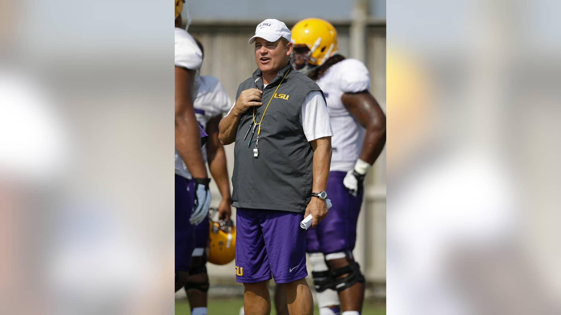 FILE - In this Aug. 6, 2014, file photo, LSU head coach Les Miles runs drills during their NCAA college football practice in Baton Rouge, La. Miles has yet to announce a starting quarterback and it remains to be seen how much of a role freshman running back Leonard Fournette will have in the offense. (AP Photo/Gerald Herbert, File)