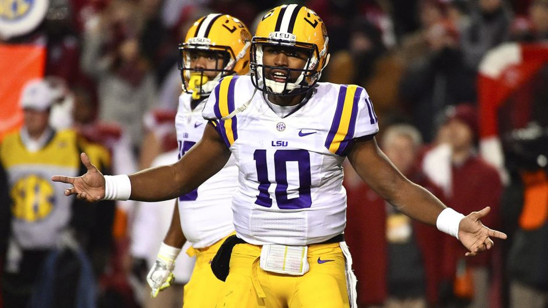 Nov 15, 2014; Fayetteville, AR, USA; LSU Tigers quarterback Anthony Jennings (10) signals to the sidelines in the game between the Arkansas Razorbacks and the LSU Tigers during the first half at Donald W. Reynolds Razorback Stadium. Mandatory Credit: Jasen Vinlove-USA TODAY Sports