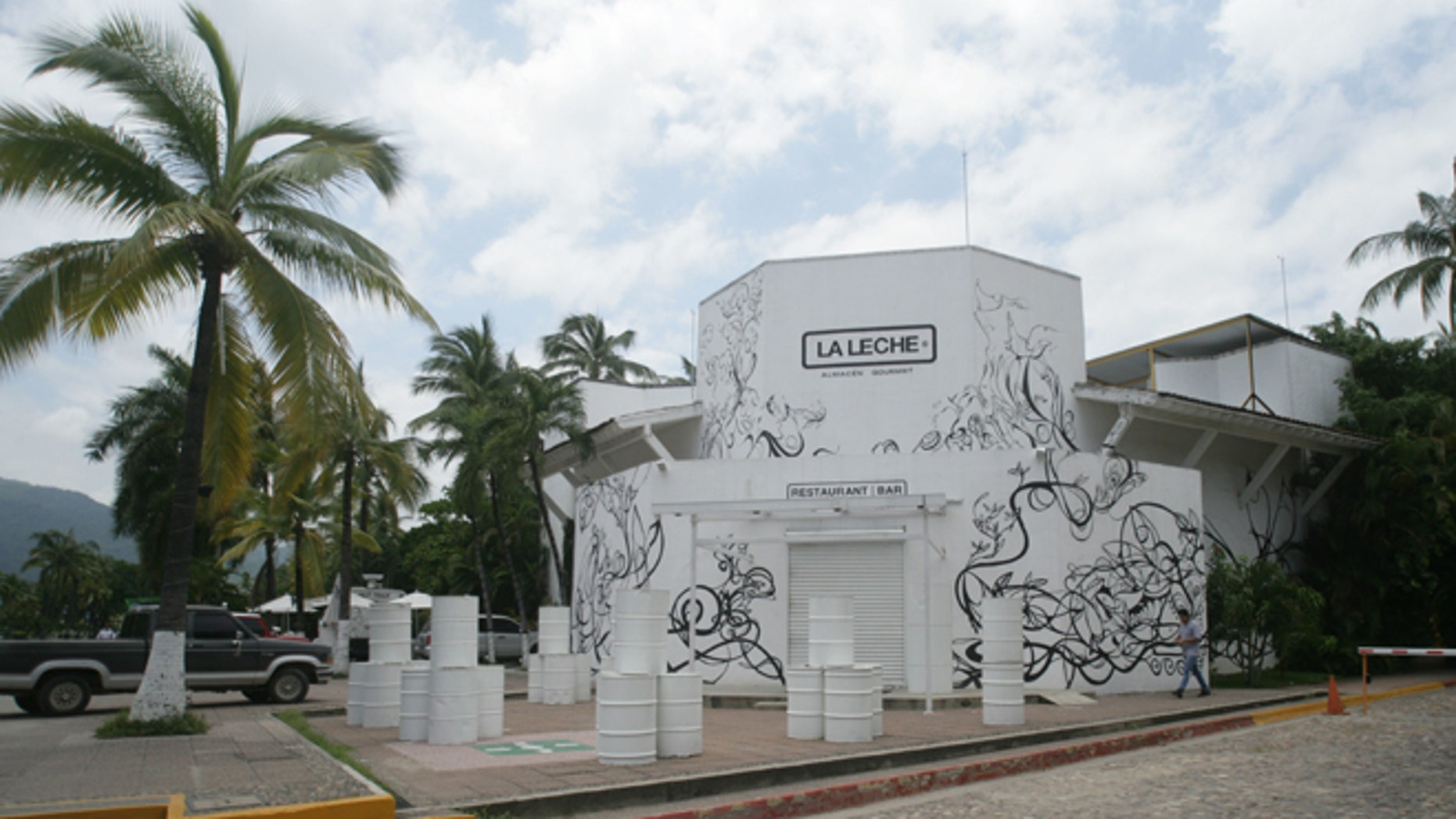 """The entrance of the restaurant """"La Leche"""" stands closed after armed men abducted as many as 16 people who were dining in the upscale restaurant in Puerto Vallarta, Mexico, Monday, Aug. 15, 2016. Jalisco state prosecutor Eduardo Almaguer said in a news conference that preliminary results of the investigation indicate that all involved, kidnappers and kidnapped, were members of criminal organizations. (AP Photo/David Diaz)"""