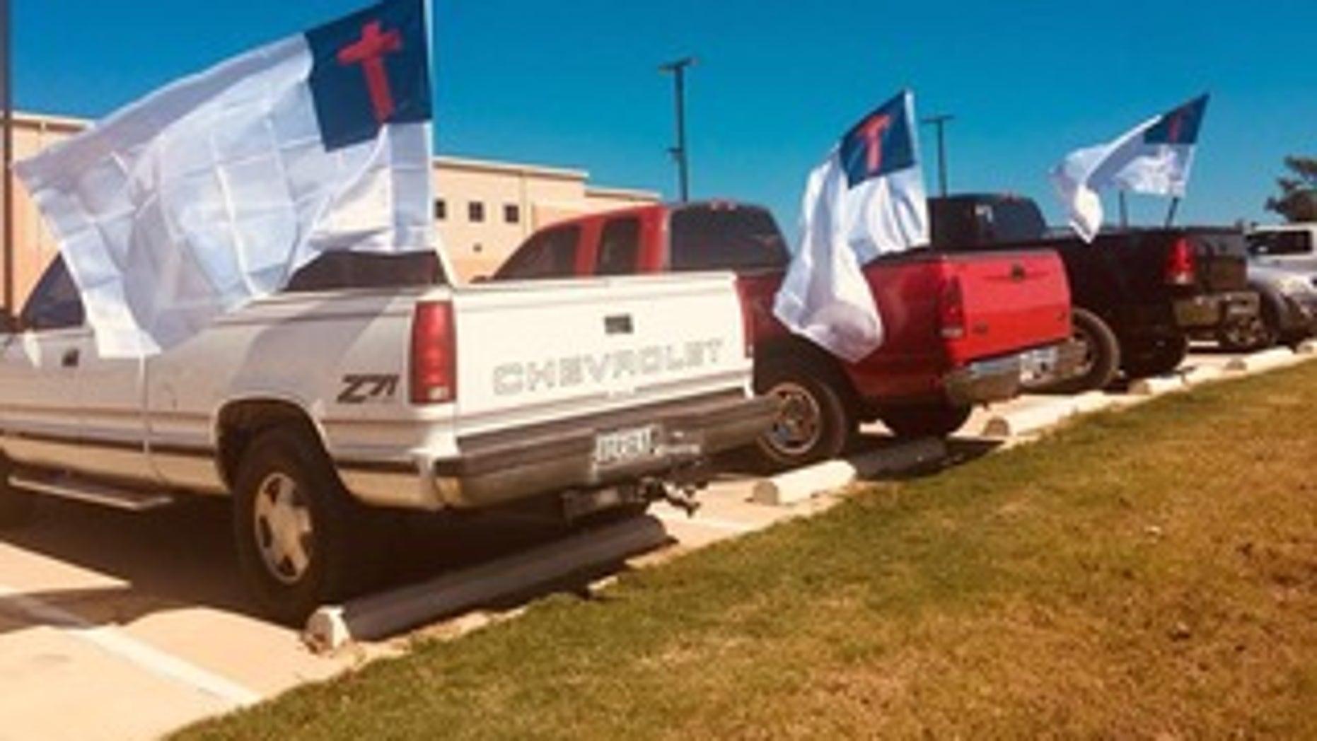 Students' trucks flying the Christian flag at LaPoynor High School in LaRue, Texas.