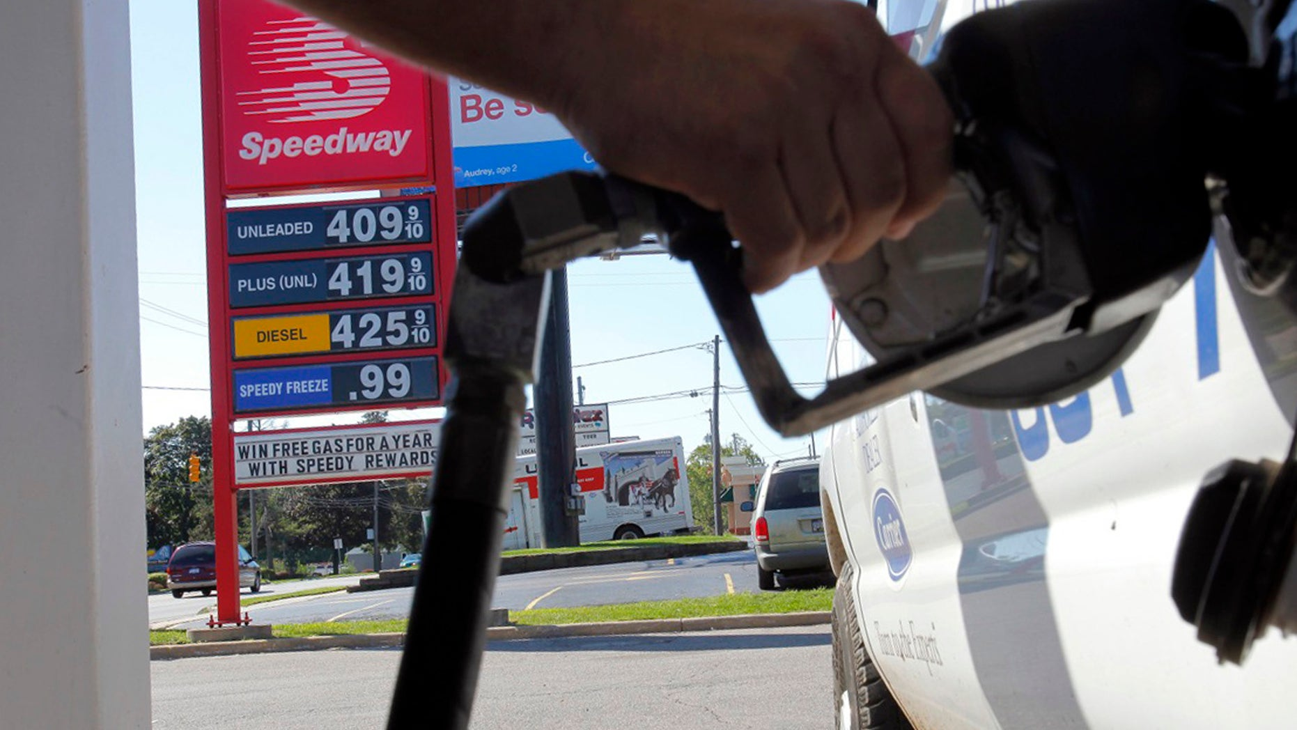 FILE-In this Tuesday, Aug. 28, 2012, file photo, a  man pumps gas into his van while a sign advertises that a gallon of regular unleaded costs $4.09 at the Speedway on South Westnedge Avenue in Kalamazoo, Mich. Drivers are facing the biggest one-day jump in gasoline prices in 18 months, Wednesday, Aug. 29, 2012, as Hurricane Isaac swamps the nation's oil and gas hub along the Gulf Coast. The nationwide average for a gallon of regular gas rose a nickel Wednesday to $3.80 as refineries shut down or cut back to protect against Isaac's high winds and heavy rain. (AP Photo/Kalamazoo Gazette, Mark Bugnaski)