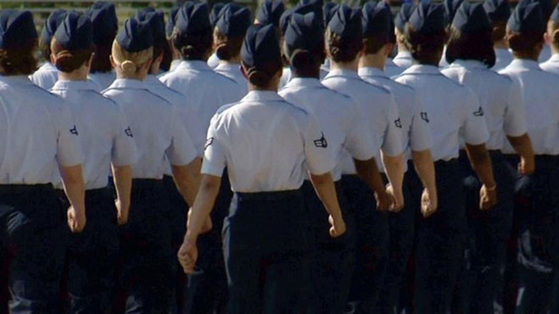 In this June 22, 2012, image made from video, female airmen march during graduation at Lackland Air Force Base in San Antonio.
