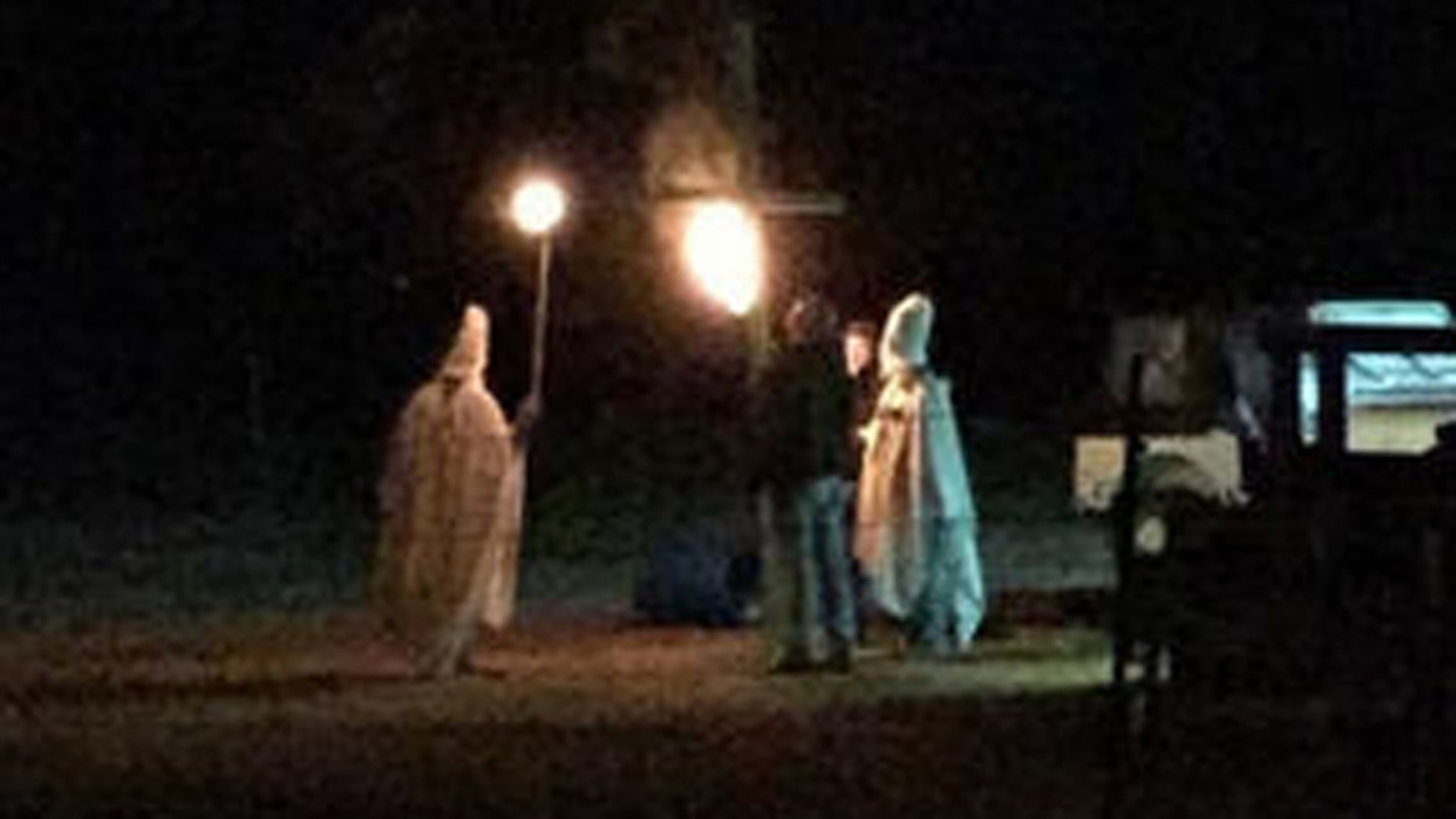 Oct. 31, 2015: This photo shows a group of people taking part in a mock Ku Klux Klan rally in Lahoma, Okla. The husband of Lahoma's mayor has since apologized for taking part in what authorities dubbed a 'Halloween prank gone wrong'. (Facebook)