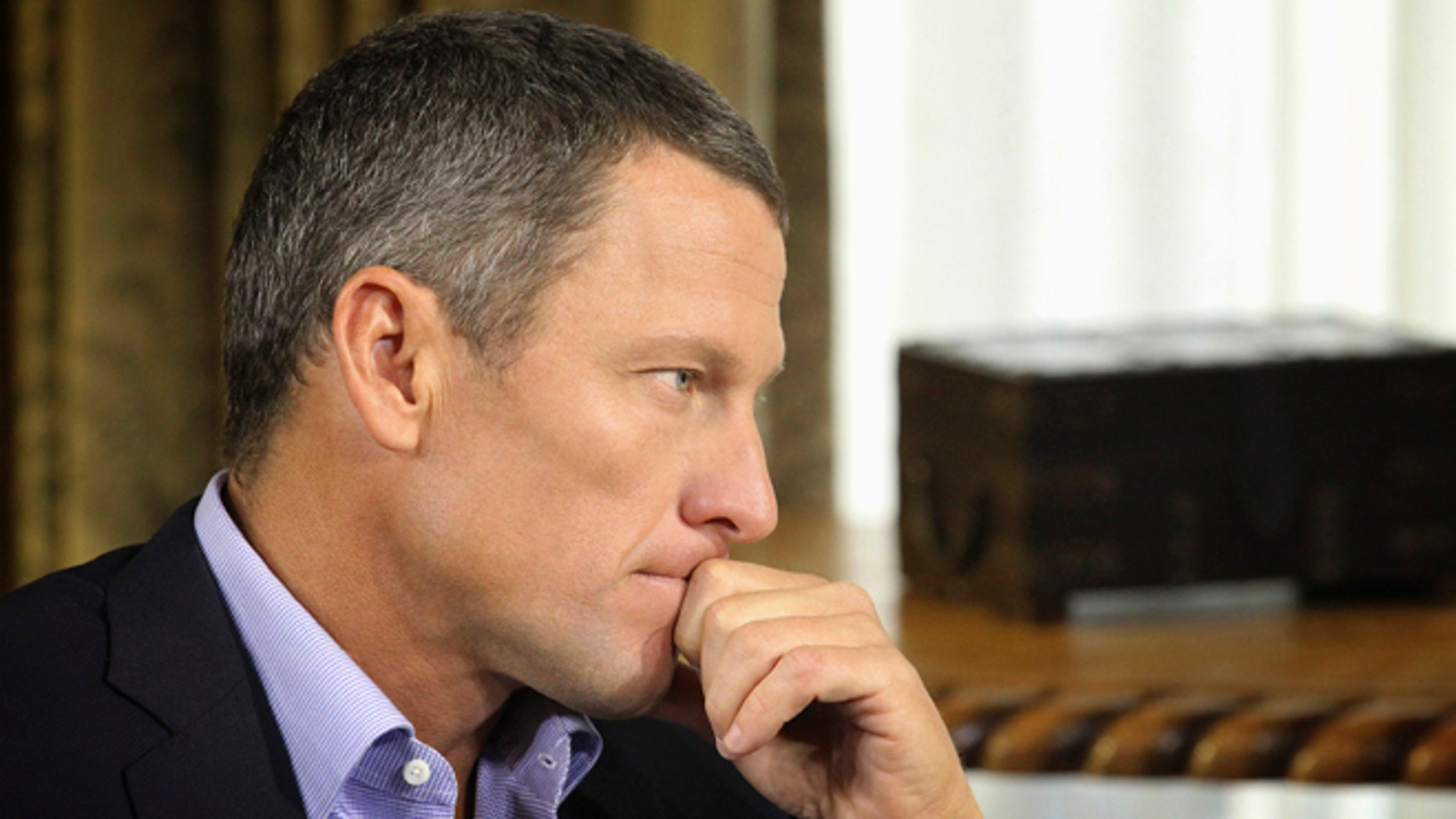 """In this Monday, Jan. 14, 2013, file photo provided by Harpo Studios Inc., Lance Armstrong listens as he is interviewed by talk show host Oprah Winfrey during taping for the show """"Oprah and Lance Armstrong: The Worldwide Exclusive"""" in Austin, Texas."""