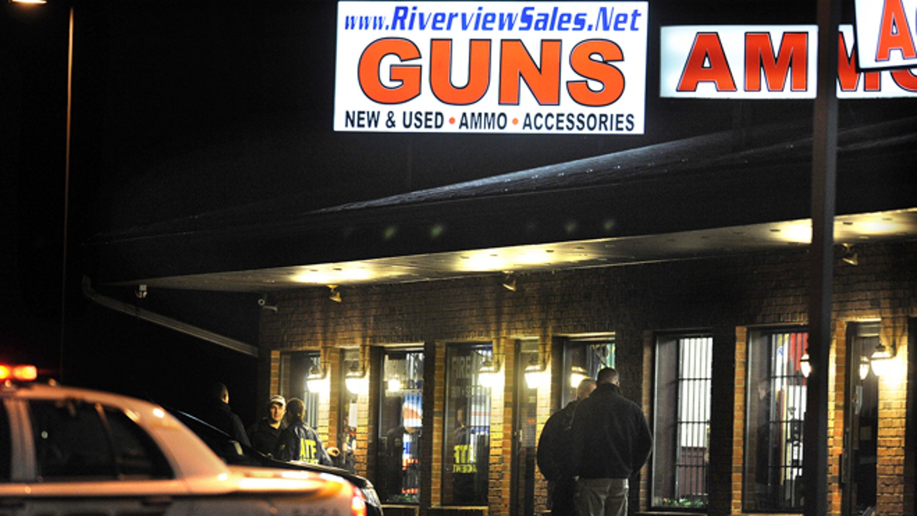 Dec. 20, 2012: In this photo, law enforcement officials stand outside Riverview Gun Sales, as authorities raid the store in East Windsor, Conn.