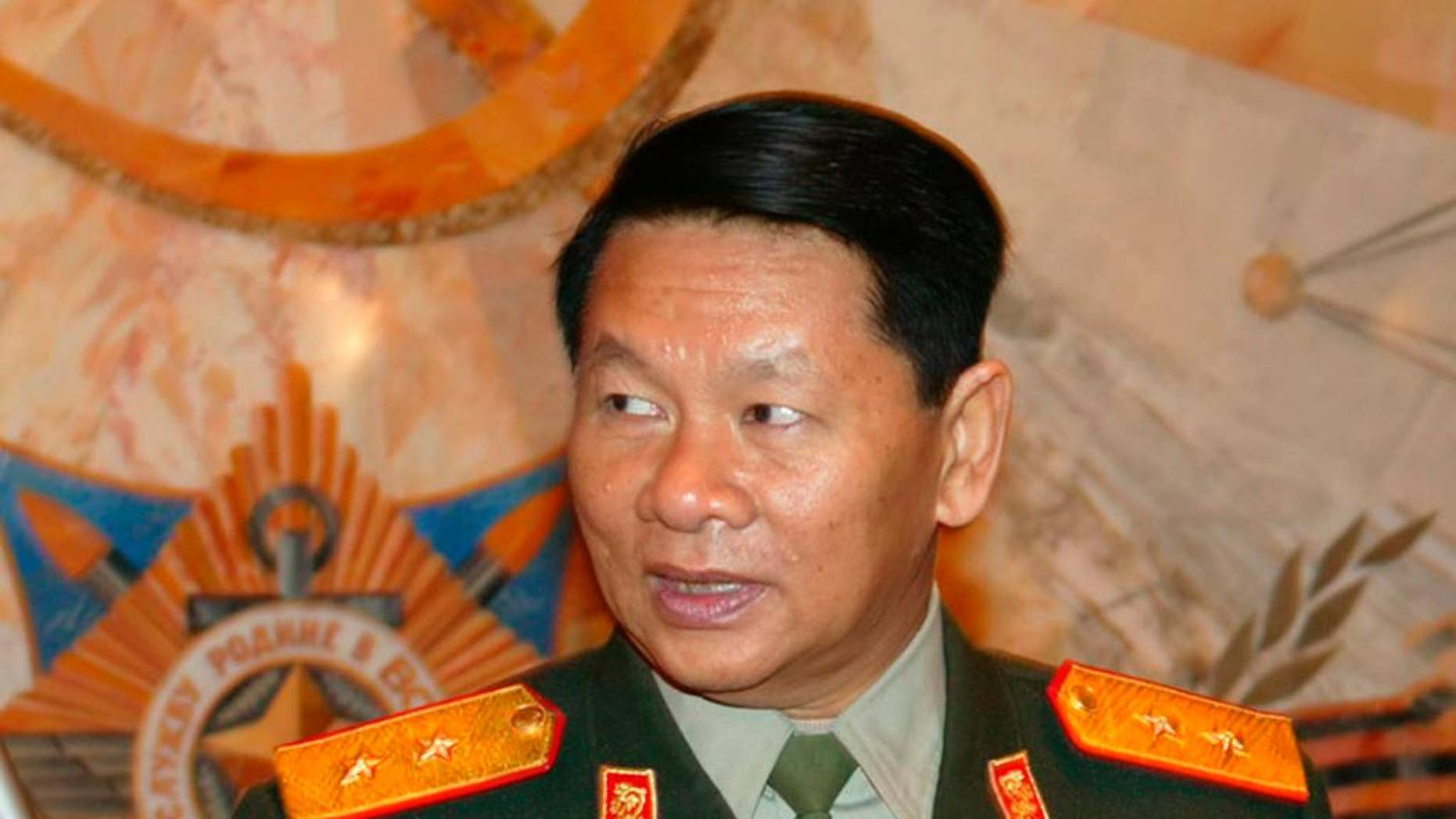 FILE - Laotian Defense Minister, Douangchay Phichit, is seen during a visit to Moscow in this Tuesday, April 27, 2004 file photo. A Laos air force plane believed to be carrying 20 people including the country's defense minister crashed on Saturday May 17, 2014, Thailand's Foreign Ministry said.  (AP Photo/File)