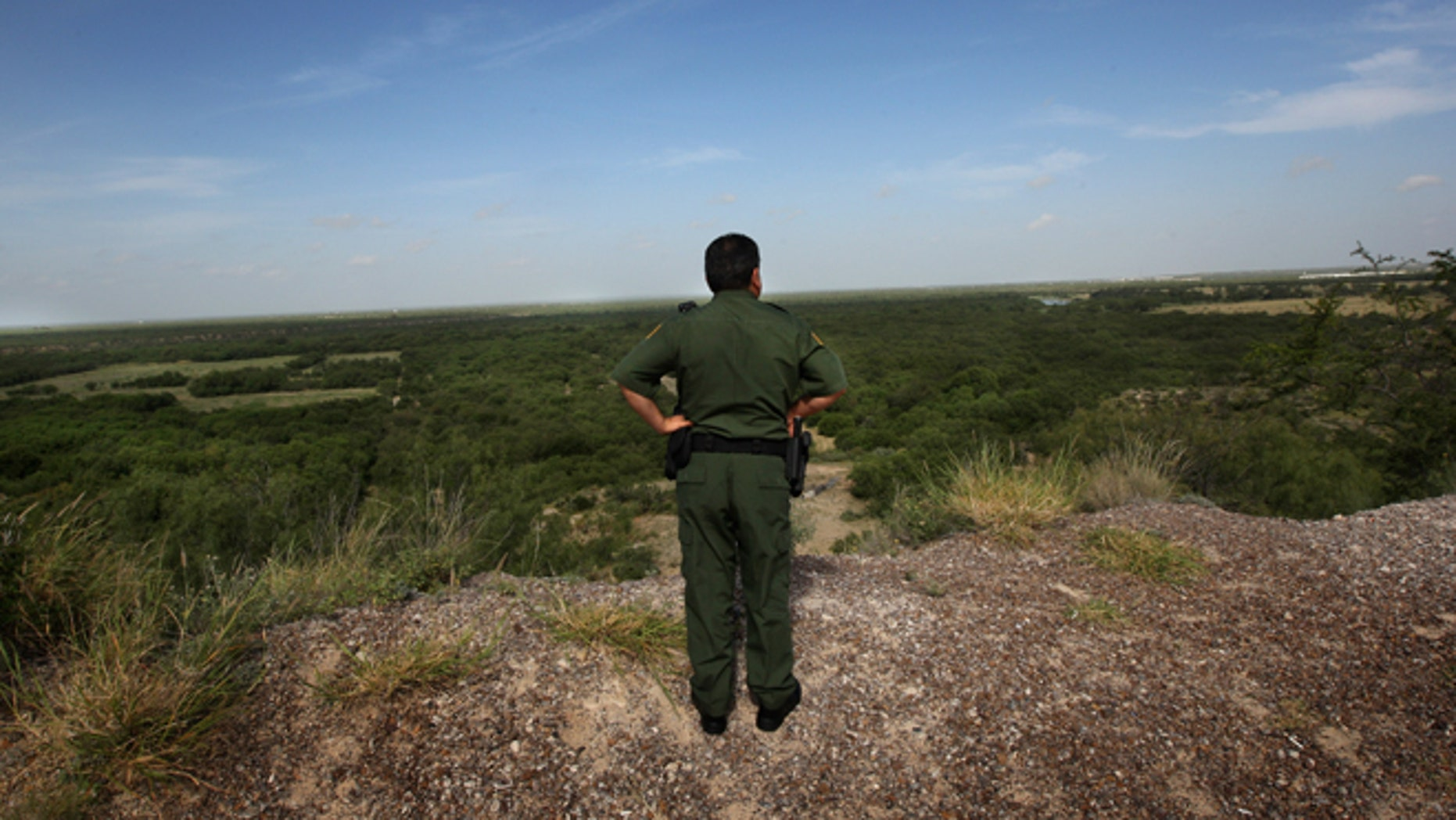 LAREDO, TX - AUGUST 07:  U.S. Border Patrol supervisor Eugenio Rodriguez looks over the landscape near the Rio Grande River and surrounding environs August 7, 2008 in Laredo, Texas. U.S. Border patrol agents constantly monitor the border for illegal crossings, as part of their efforts to stop illegal immigrants, drug traffickers and terrorists from crossing illegally into the United States. Securing the nation's borders is an important topic in this year's presidential campaign. Since 9/11, the Border Patrol has grown by about a third to more than 15,000 agents.  (Photo by John Moore/Getty Images)