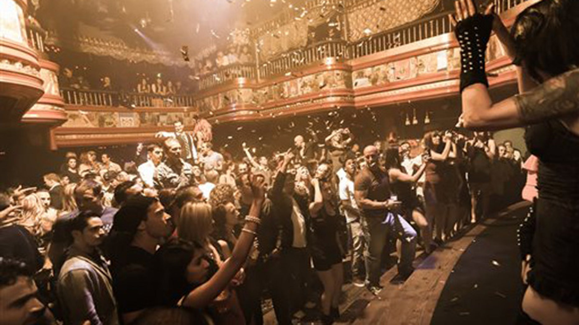 In this image provided by The Act nightclub, patrons enjoy a perfromance at  the club