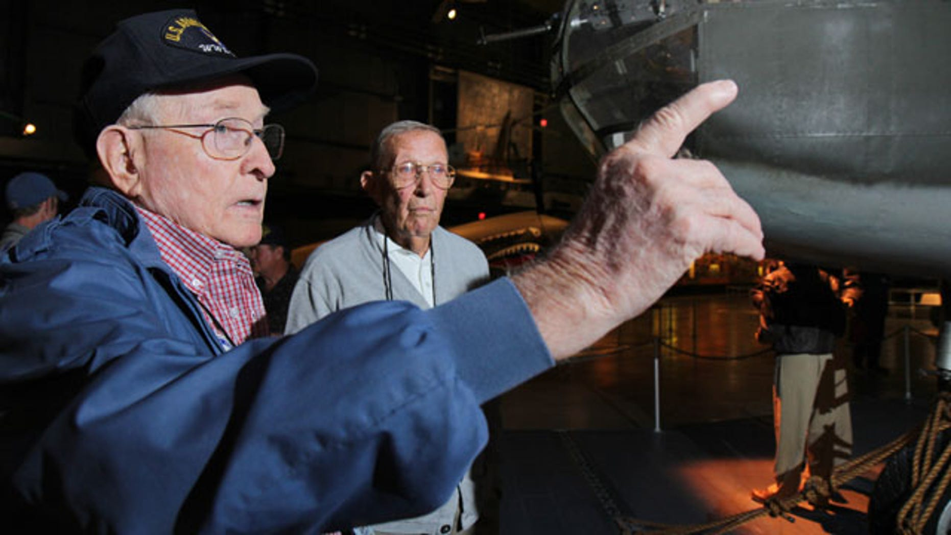 September 27, 2013: Former B-25 crewman Robert Crouse and former pilot Paul Young talk about their World War II experiences during a reunion of the 57th Bomb Wing in front of a B-25 bomber in the U.S. Air Force Museum at Wright Patterson Air Force base in Dayton, Ohio. (AP Photo)