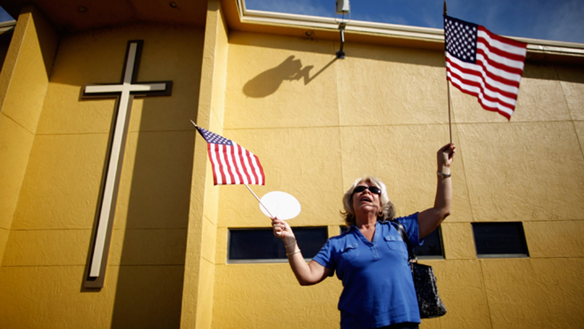 A supporter of Republican presidential candidate and former Speaker of the House Newt Gingrich (R-GA) waits for his arrival outside Centro de la Familia evangelical church January 28, 2012 in Orlando, Florida.