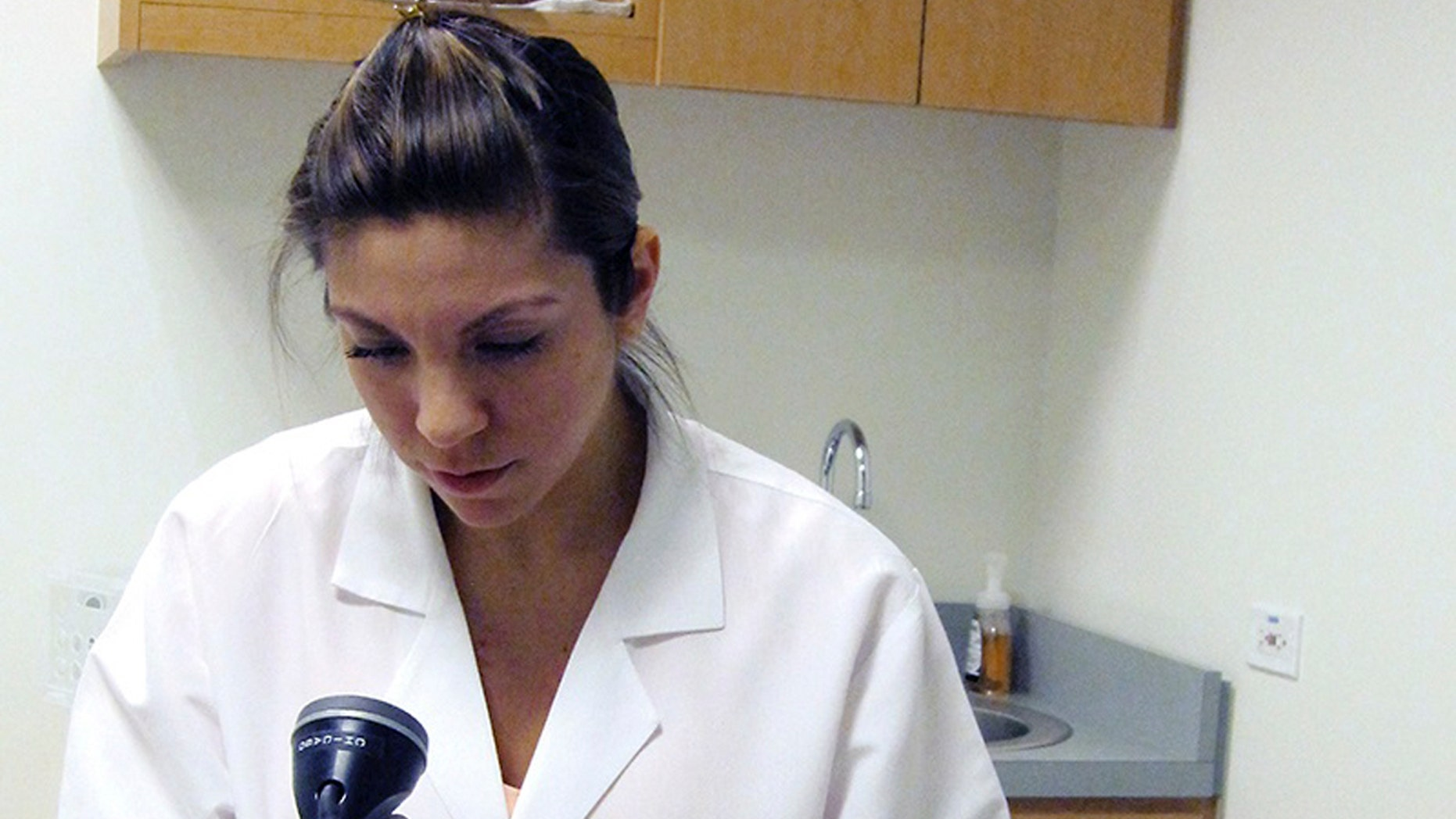 This 2010 photo from the National Heart, Lung and Blood Institute provided by the University of Illinois at Chicago shows a study participant undergoing a medical exam at the Chicago site of landmark research on the health of Hispanics in the United States. The ongoing National Heart, Lung and Blood Institute study involves more than 16,000 subjects in the Bronx, Chicago, Miami and San Diego. Results released Monday, Feb. 24, 2014, show health differences by country of origin.(AP Photo/Courtesy of the National Heart, Lung and Blood Institute via the University of Illinois at Chicago, Dr. Larissa Aviles-Santa)