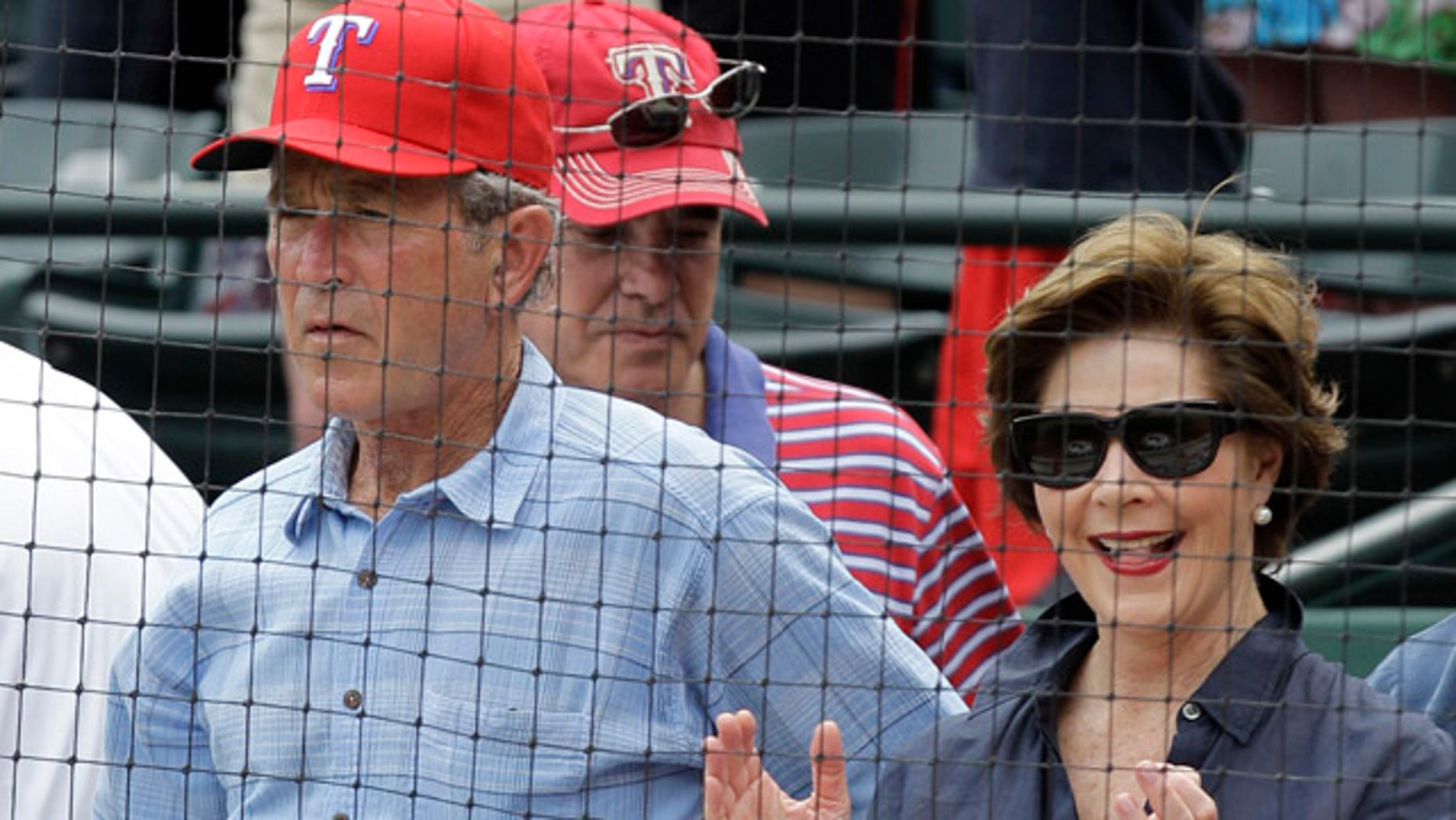 April 24: Former president George W. Bush and Laura take in an afternoon baseball game between the Texas Rangers and the Kansas City Royals
