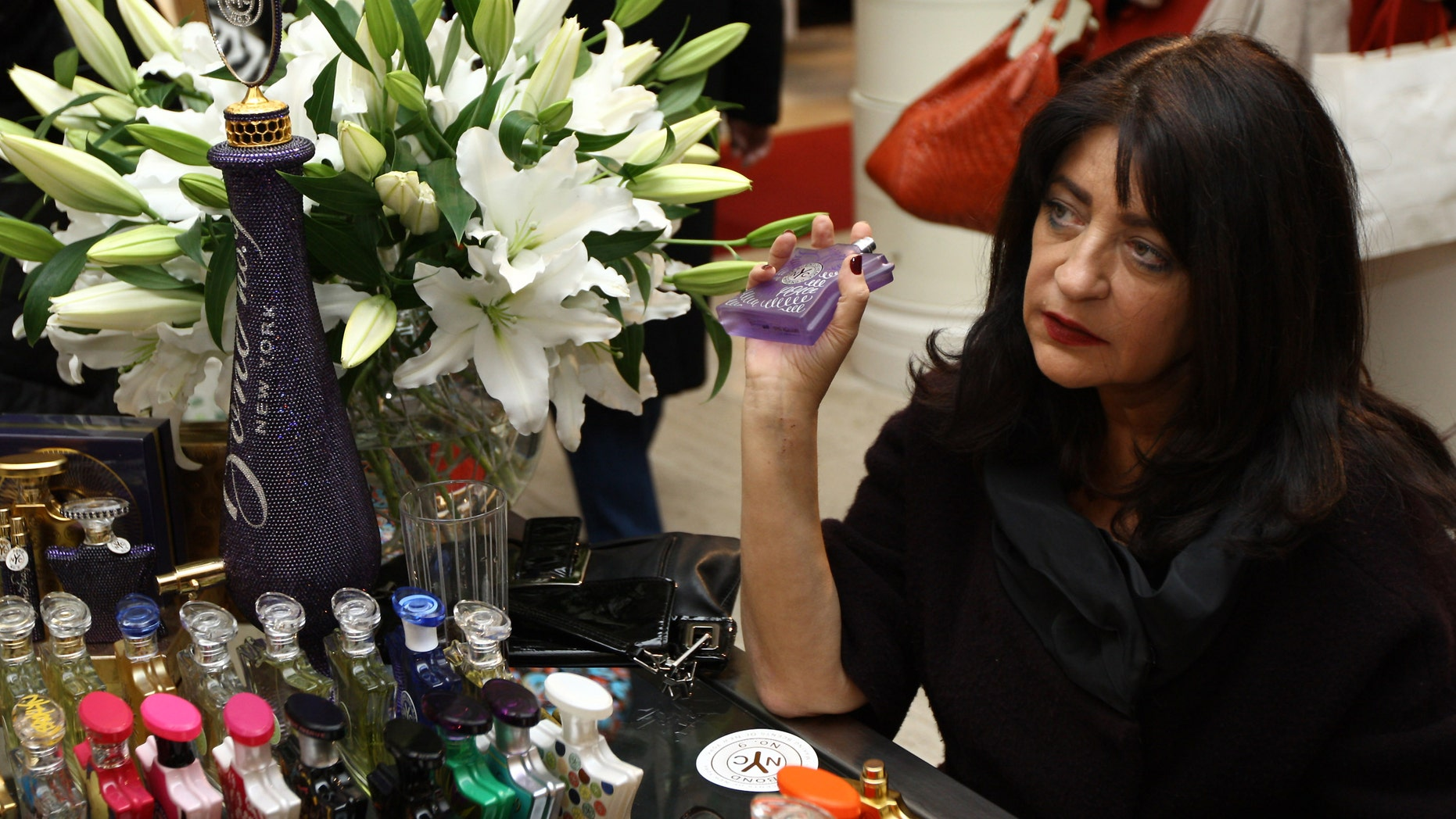NEW YORK - DECEMBER 19: Laurice Rahme signs bottles of her Bond No. 9 perfume for the 'Ultimate NY Gift' at Saks Fifth Avenue on December 19, 2009 in New York City. (Photo by Neilson Barnard/Getty Images for Bond No. 9)