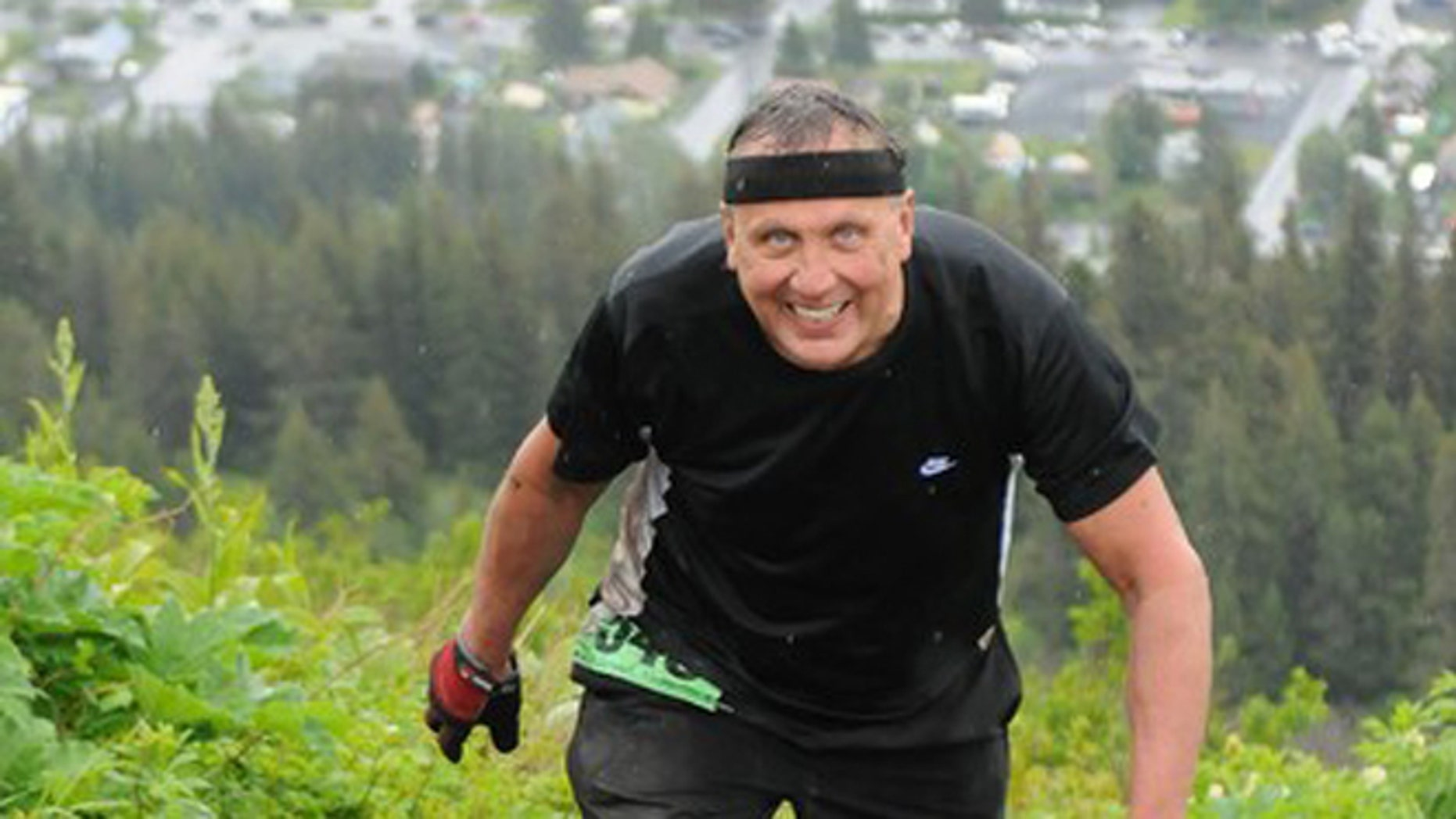 In this photo taken July 4, 2012 and provided by TSS Photography, 65-year-old Michael LeMaitre competes in the Mount Marathon race in Seward, Alaska.