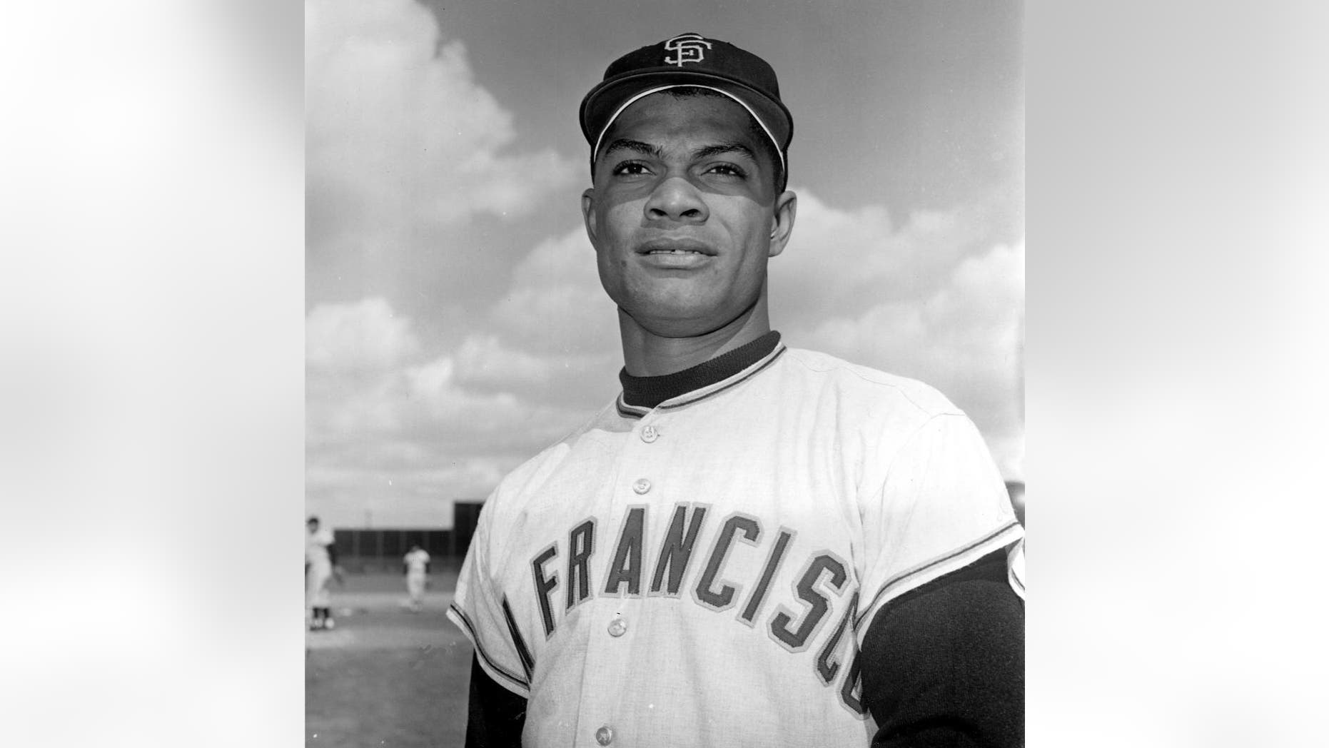In this March 8, 1962 file photo Felipe Alou, outfielder for the San Francisco Giants, poses in Casa Grande, Ariz. Alou and Orlando Cepeda were dark-skinned Latinos who knew little English when they arrived in the minor leagues as teenagers, among the first wave of Spanish-speaking players thrown into a new culture to play professional baseball. Both are encouraged to see so many young players from Latin America now arriving in the U.S. with better English skills, thanks in large part to all 30 major league organizations putting more emphasis into such training through academies in the Dominican Republic and Venezuela. (AP Photo/File)