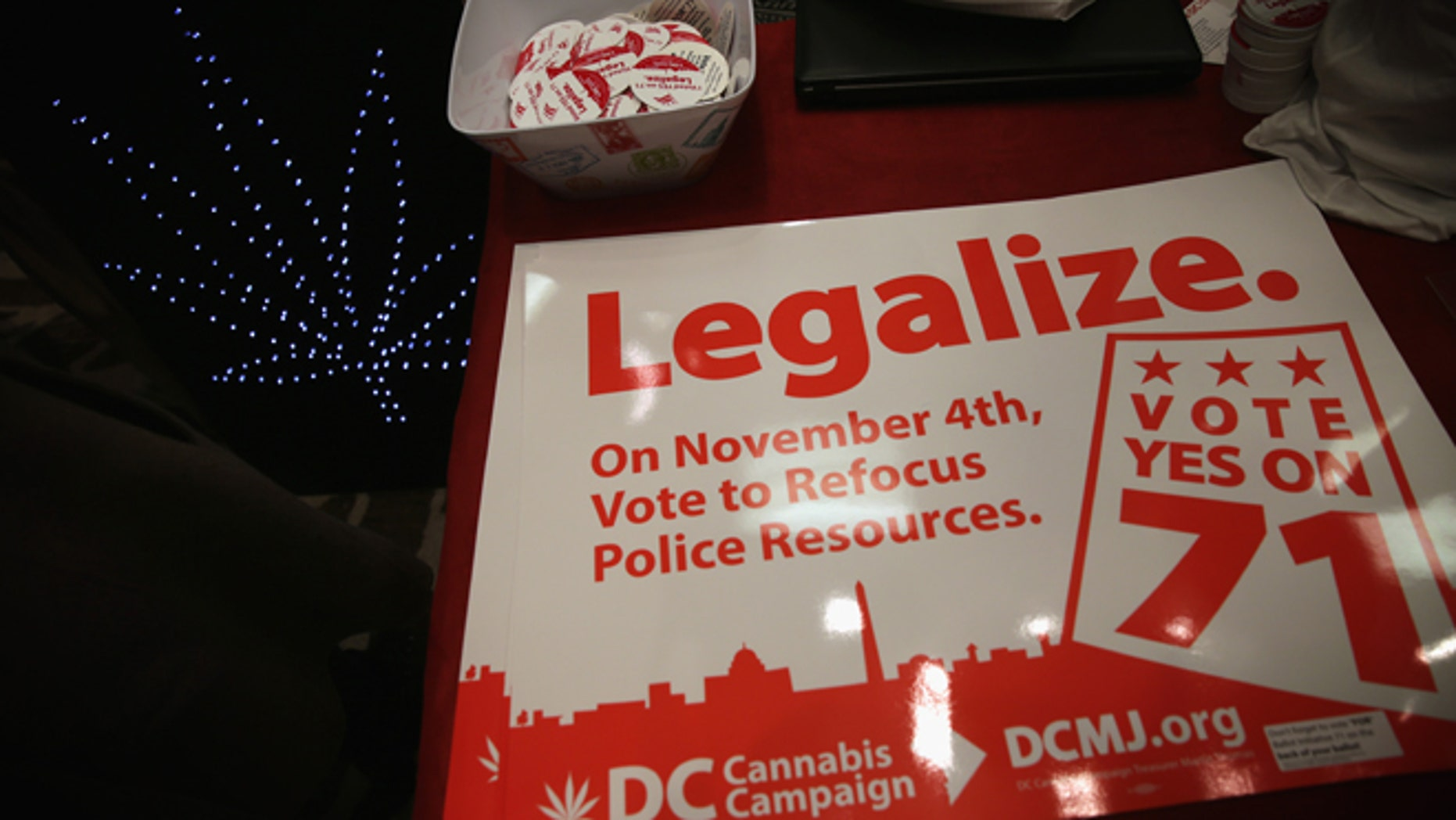 WASHINGTON, DC - FEBRUARY 28:  Posters and stickers regarding Washington, DC's marijuana legalization are seen during a ComfyTree Cannabis Academy conference February 28, 2015 in Washington, DC. Attendees participated in the conference to gain knowledge on how to legally enter and operate in the cannabis industry.  (Photo by Alex Wong/Getty Images)