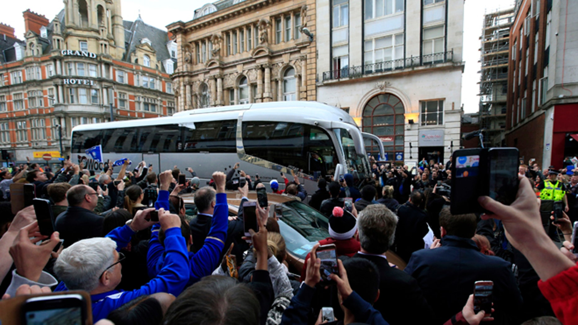Crowds congregate as the Leicester City team bus arrives  at San Carlo Pizzeria for a celebratory lunch in Leicester, England Tuesday May 3, 2016. Leicester  clinched the most improbable title of the Premier League era when second-place Tottenham was held to a 2-2 draw at Chelsea on Monday night.  (Jonathan Brady/PA via AP)  UNITED KINGDOM OUT  NO SALES NO ARCHIVE