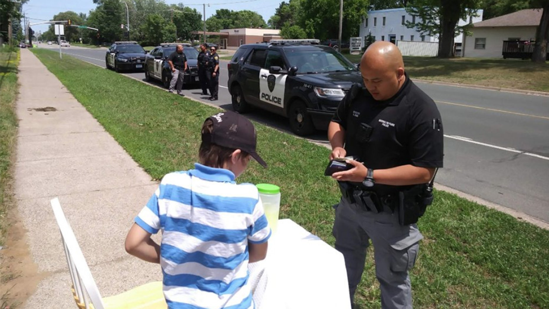 A group of Brooklyn Park police officers saved the day after a 9-year-old's lemonade stand was robbed by two older kids.