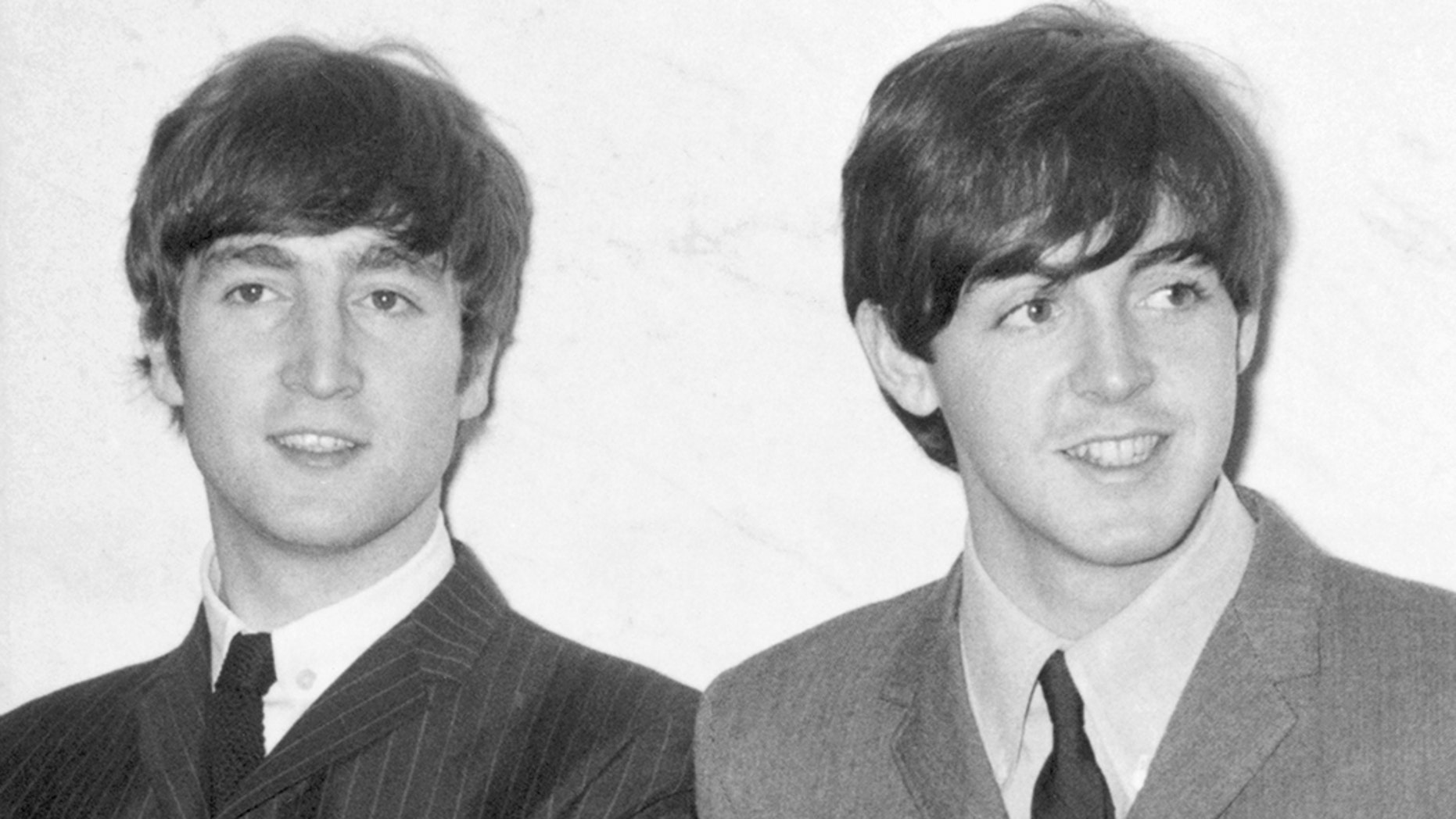 """Paul McCartney admitted that he and John Lennon """"were competitive"""" with each other and that his former Beatles bandmate only """"once"""" praised one of his songs. John Lennon and Paul McCartney seen in this December 1963 photo. John Lennon and Paul McCartney seen in this December 1963 photo. Lennon and McCartney smiling in a photo from 1963."""
