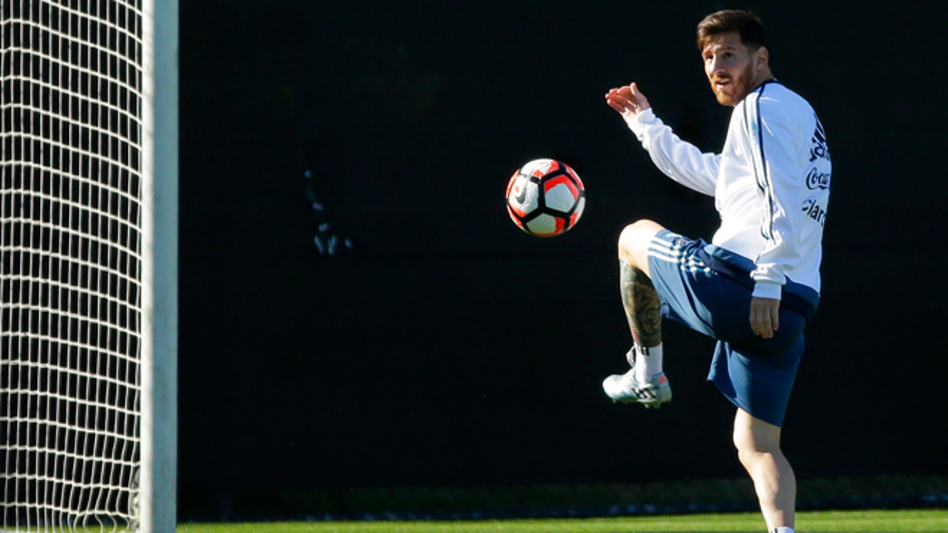 Argentina midfielder Lionel Messi kicks the ball during practice, Monday, June 13, 2016, in Tukwila, Wash. Argentina is scheduled to face Bolivia on Tuesday in a Copa America Centenario soccer match in Seattle. (AP Photo/Ted S. Warren)
