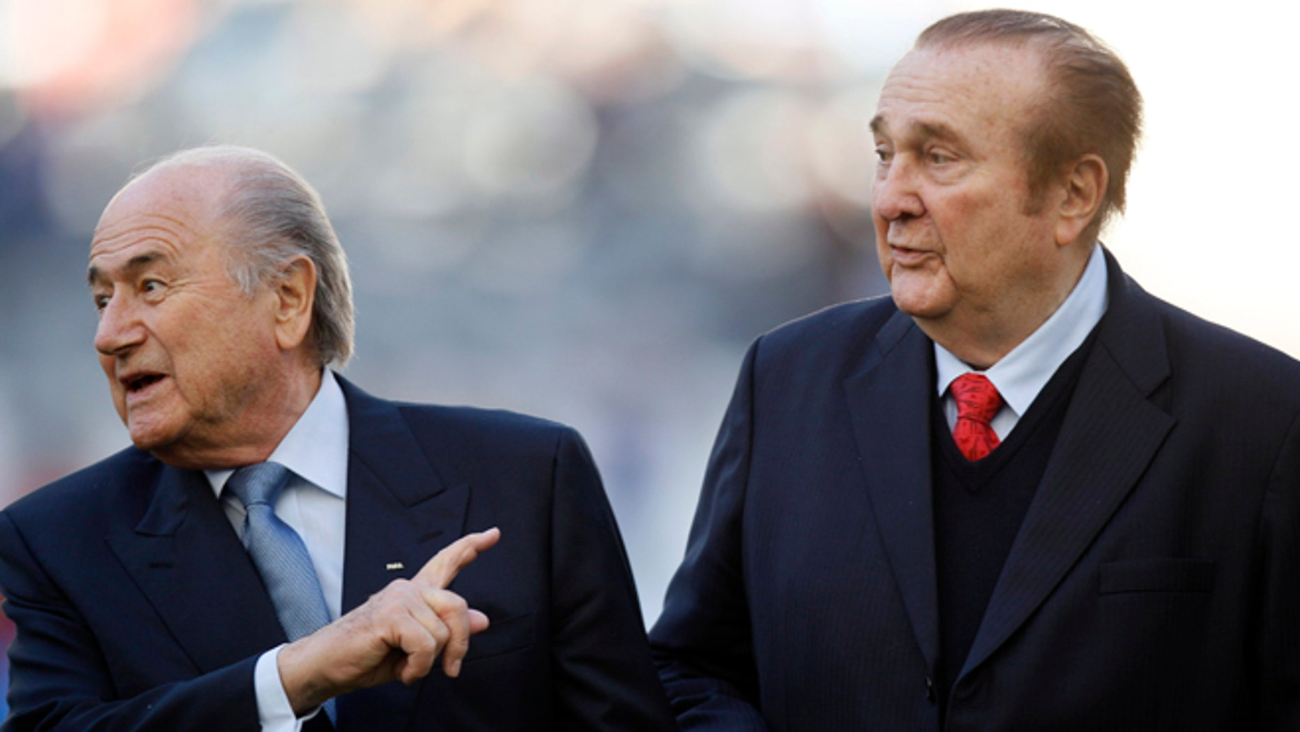 FILE - In this July 23, 2011 file photo, FIFA President Sepp Blatter, left, and CONMEBOL President Nicolás Leoz, right, stand on the pitch before the start of the Copa America third-place soccer match between Venezuela and Peru in La Plata, Argentina. Loez's lawyer said Thursday, July 23, 2015, that U.S. prosecutors in New York have asked Paraguay to extradite the former president of South America's soccer confederation and one of those charged in a corruption scandal being investigated by the U.S. Justice Department. (AP Photo/Fernando Llano, File)