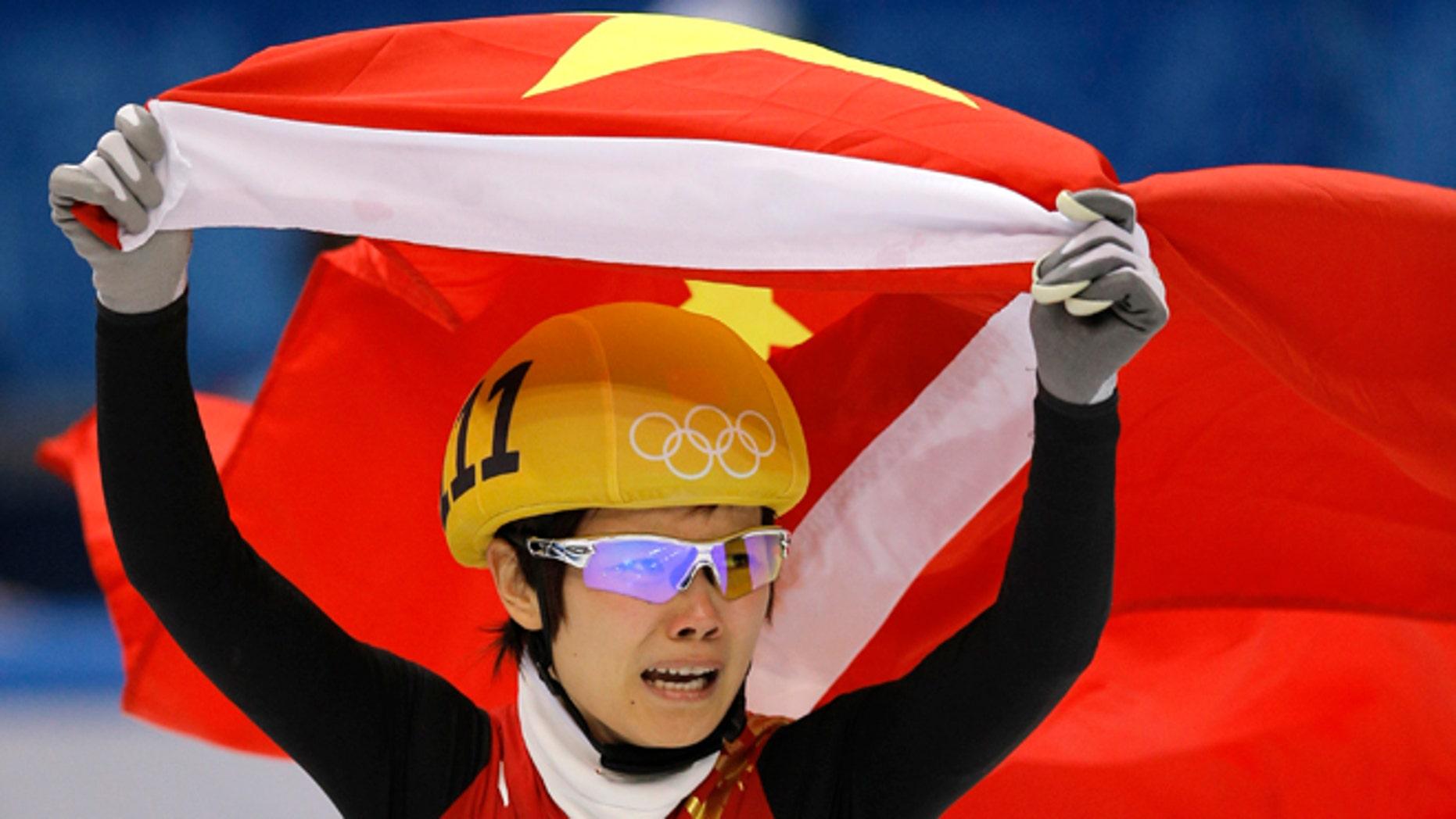 Feb. 13, 2014: Li Jianrou of China celebrates winning the women's 500m short track speedskating final at the Iceberg Skating Palace during the 2014 Winter Olympics in Sochi, Russia.