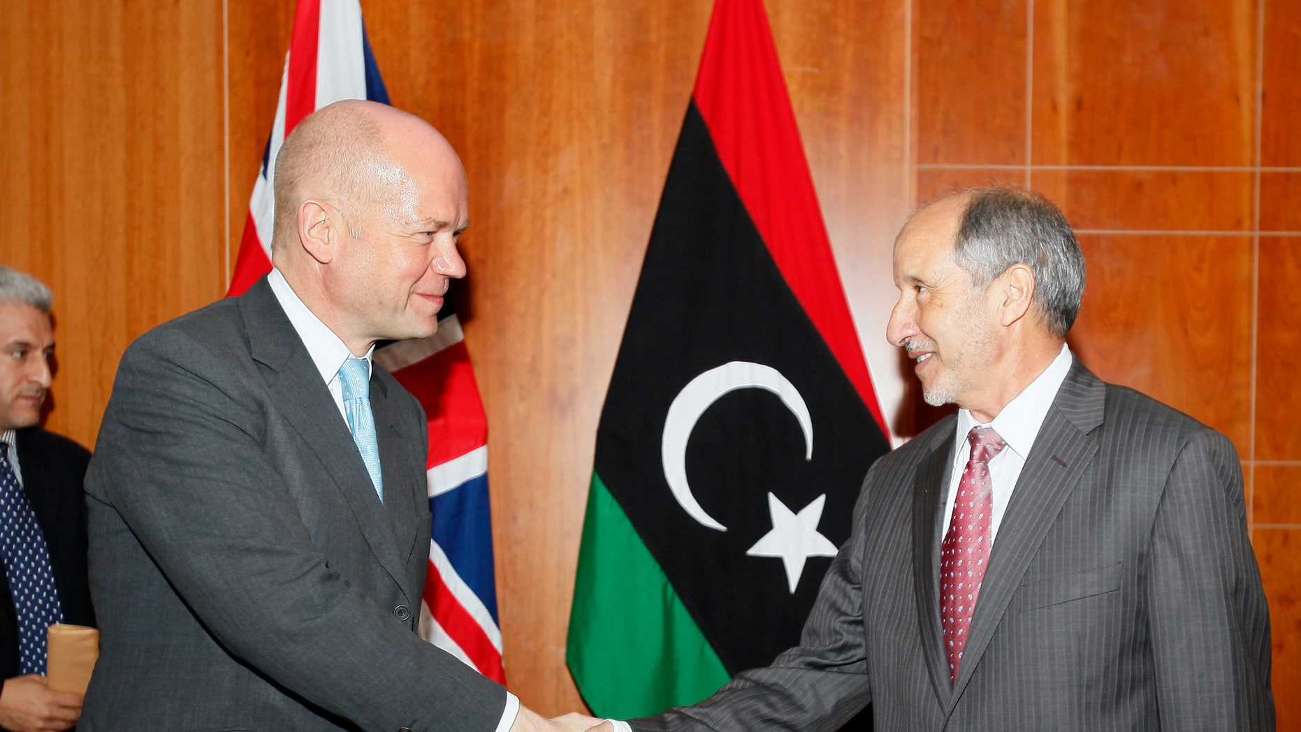 British Foreign Secretary William Hague, left, shakes hands with Libya's interim leader Mustafa Abdul-Jalil, the head of the governing National Transitional Council in Tripoli, Libya, Monday, Oct. 17, 2011.