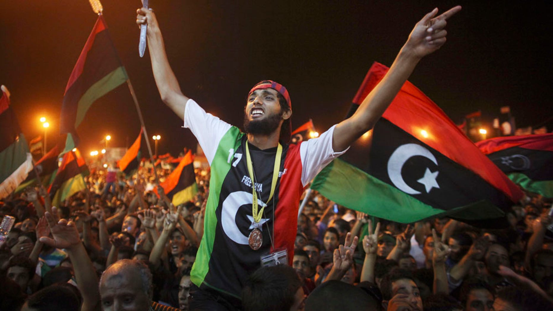 Aug. 22: People celebrate the capture in Tripoli of Qaddafi''s son and one-time heir apparent, Seif al-Islam, at the rebel-held town of Benghazi, Libya.