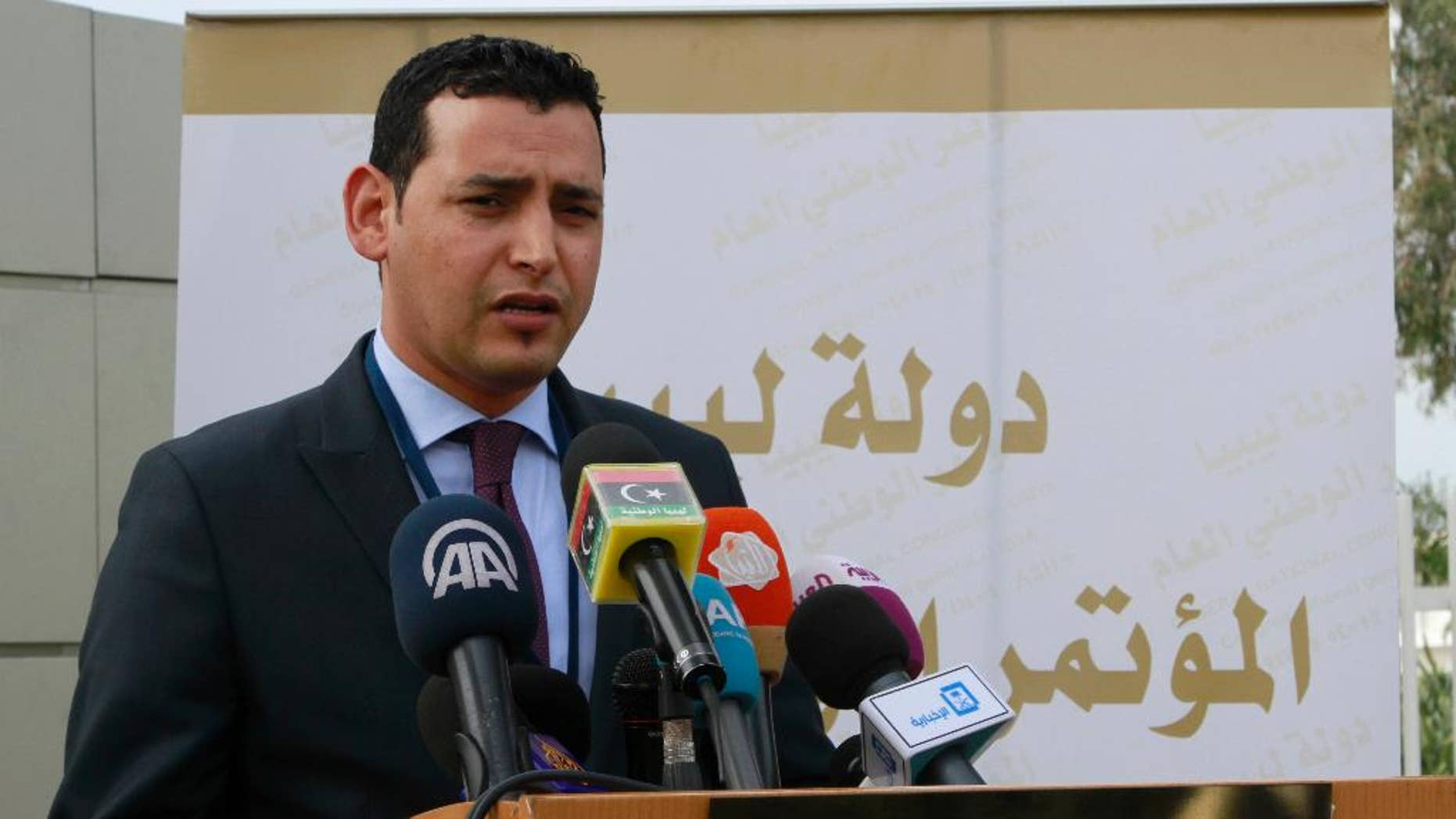 A delegation member of the Tripoli-based General National Congress, Omar Hmeidan speaks to reporters outside the conference center in Skhirat, Morocco on Friday, March 13, 2015 during the U.N.-sponsored Libyan peace talks. The fate of the talks has  been thrown into doubt after the delegation from the internationally recognized parliament in Tobruk did not show up. (AP/Paul Schemm)