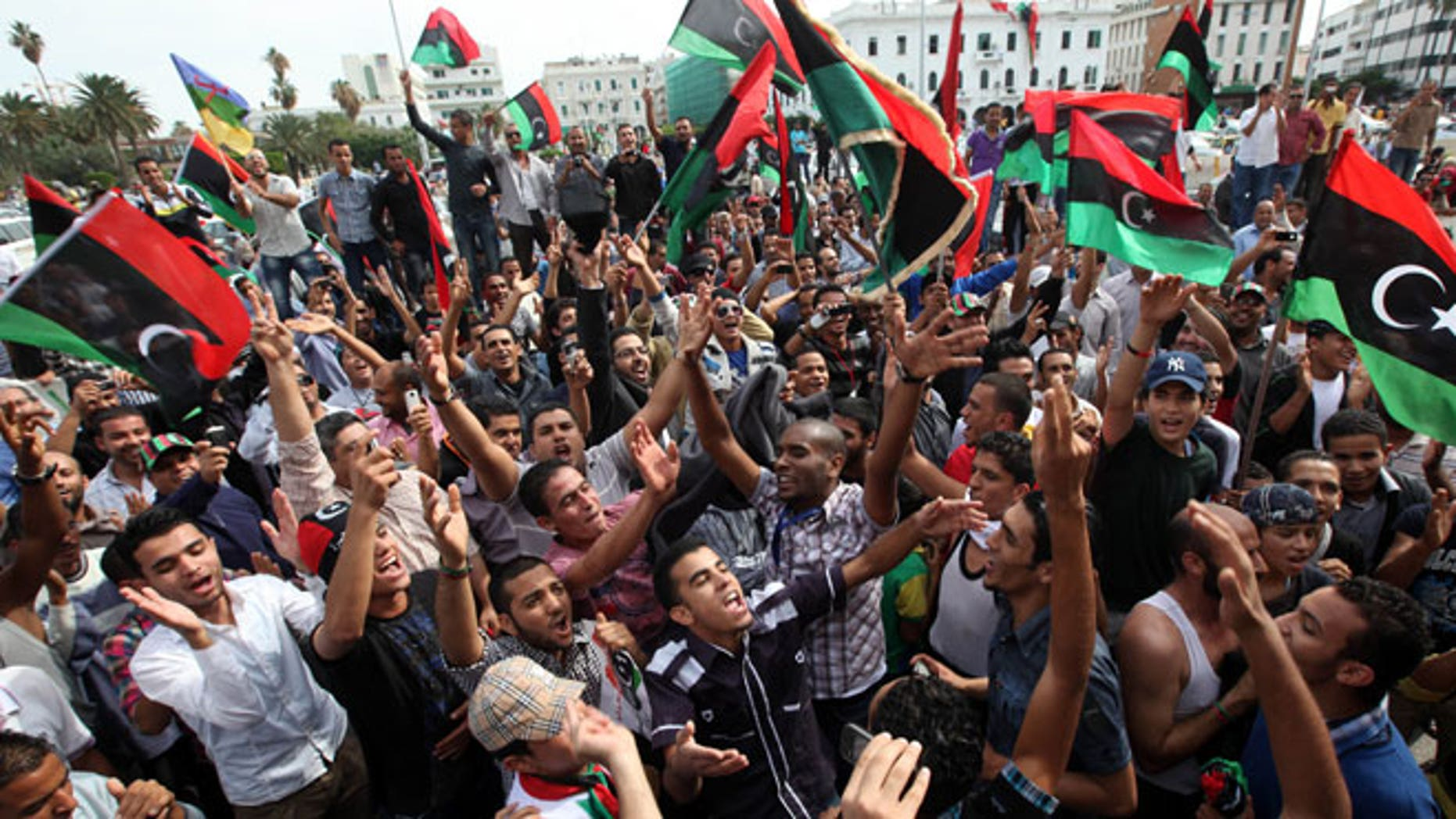 Libyan residents celebrate in Tripoli, Libya.