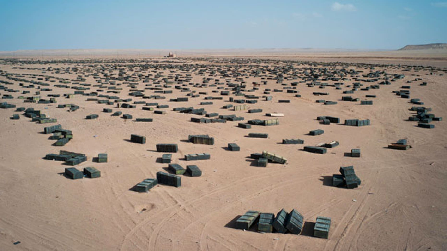 October 26, 2011 file photo: Ammunition crates are seen at an unguarded storage facility in the desert, some 62 miles south of Sirte, Libya.