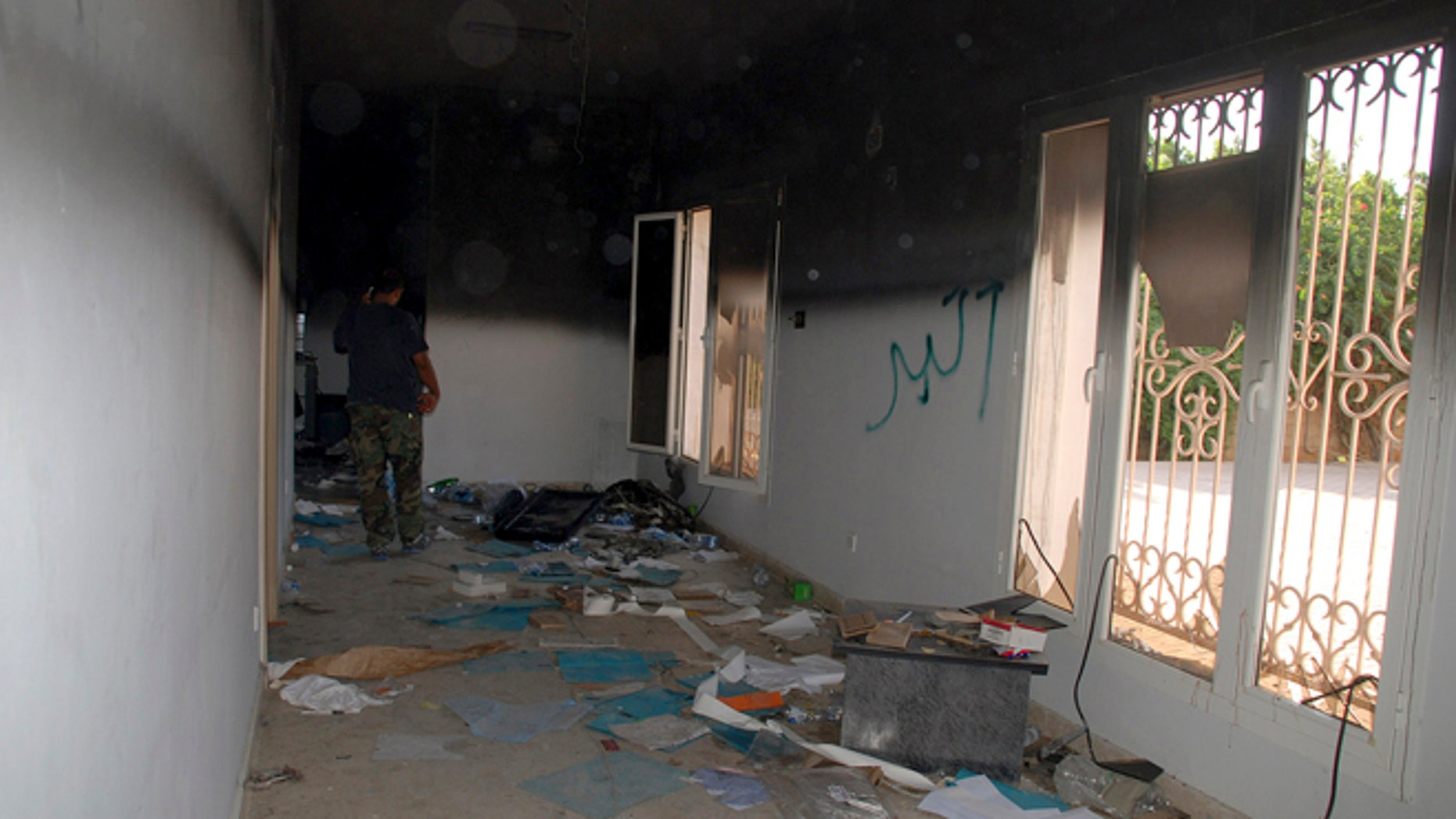 Sept. 12, 2012: This file photo shows a man walking through a room in the gutted U.S. consulate in Benghazi, Libya, after an attack that killed four Americans, including Ambassador Chris Stevens.