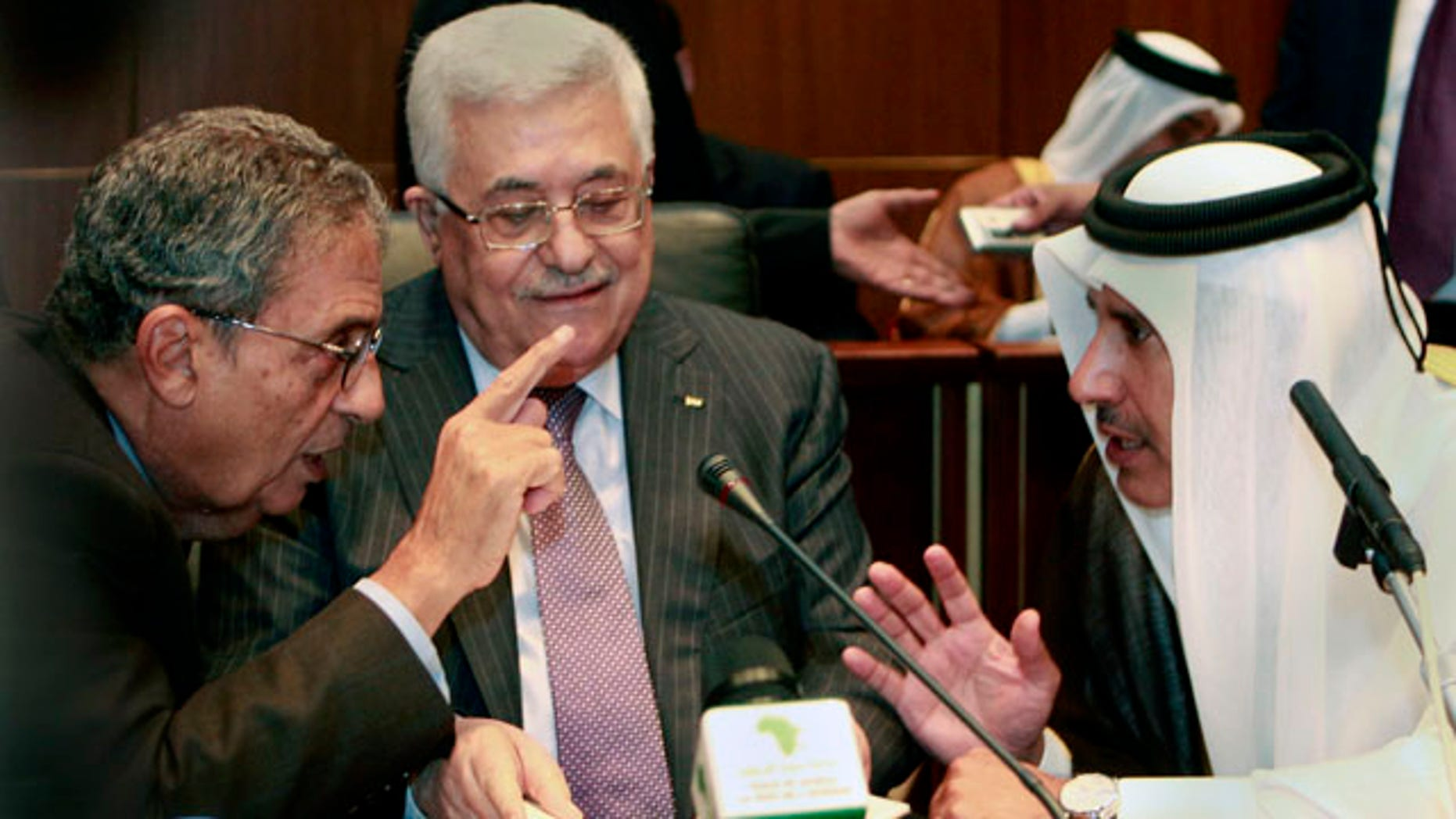 Oct. 8, 2010: Palestinian President Mahmoud Abbas, center, listens to Qatar's Foreign Minister Sheik Hamad Bin Jassem, right and Amr Moussa, Secretary general of the Arab League, during the Arab Foreign Ministers Peace Initiative meeting, in Sirte, Libya.
