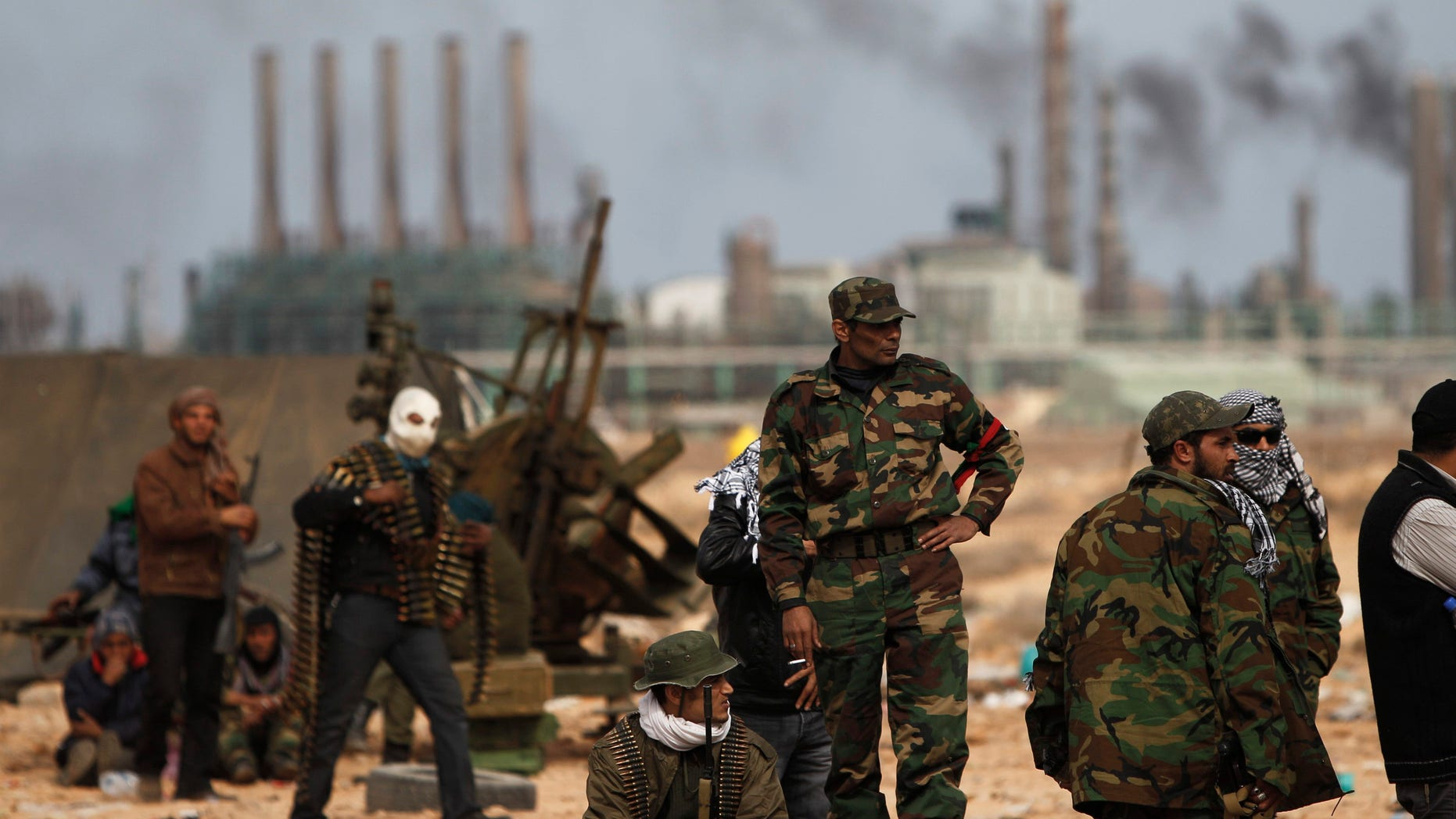 March 10: Libyan volunteers stand on the outskirts of the eastern town of Ras Lanouf, Libya.