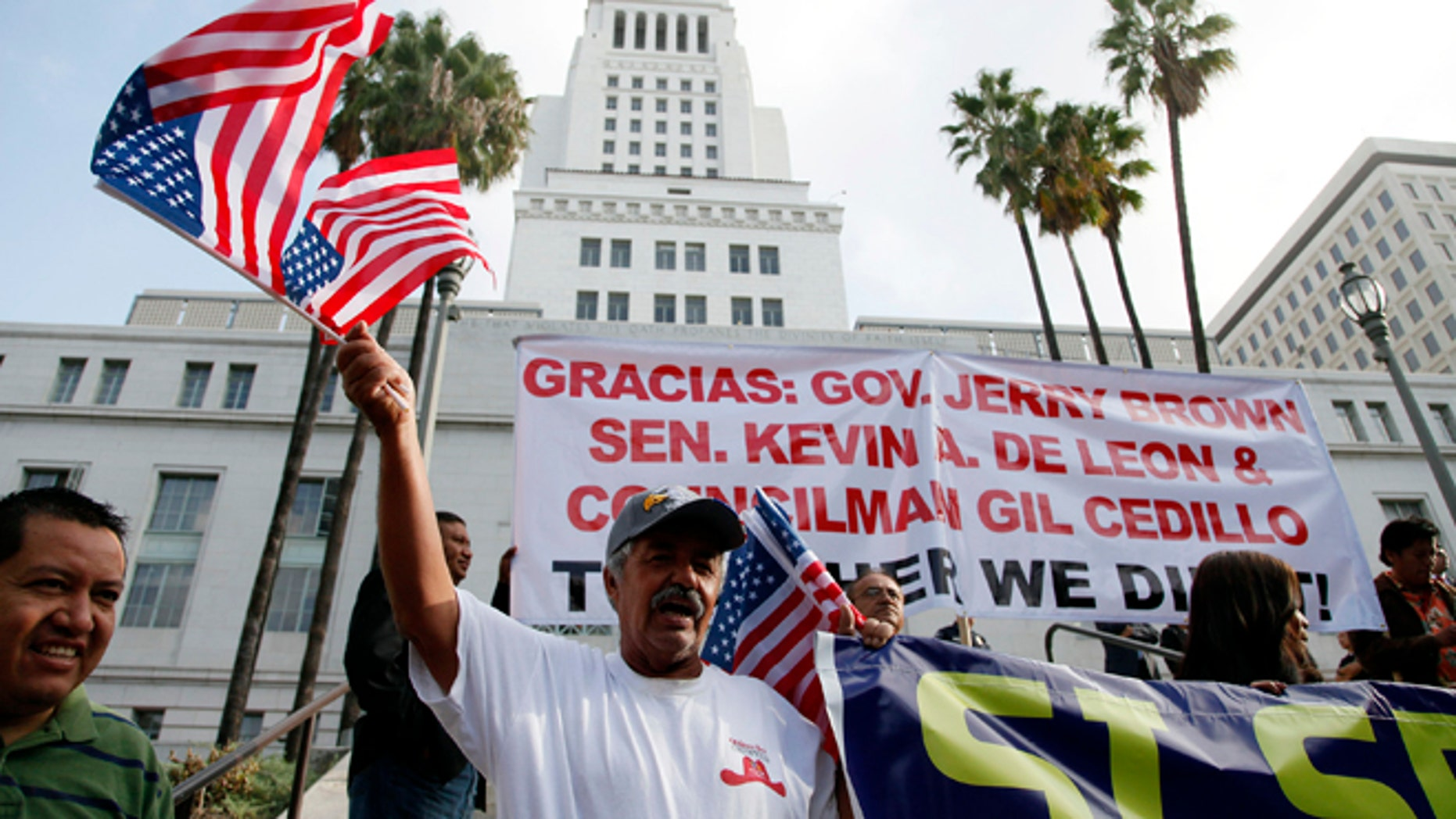 Oct. 3, 2013: Ipolito Nurez celebrates outside City Hall after California Gov. Jerry Brown signed the bill AB 60, which allows immigrants in the country illegally to obtain driver licenses.