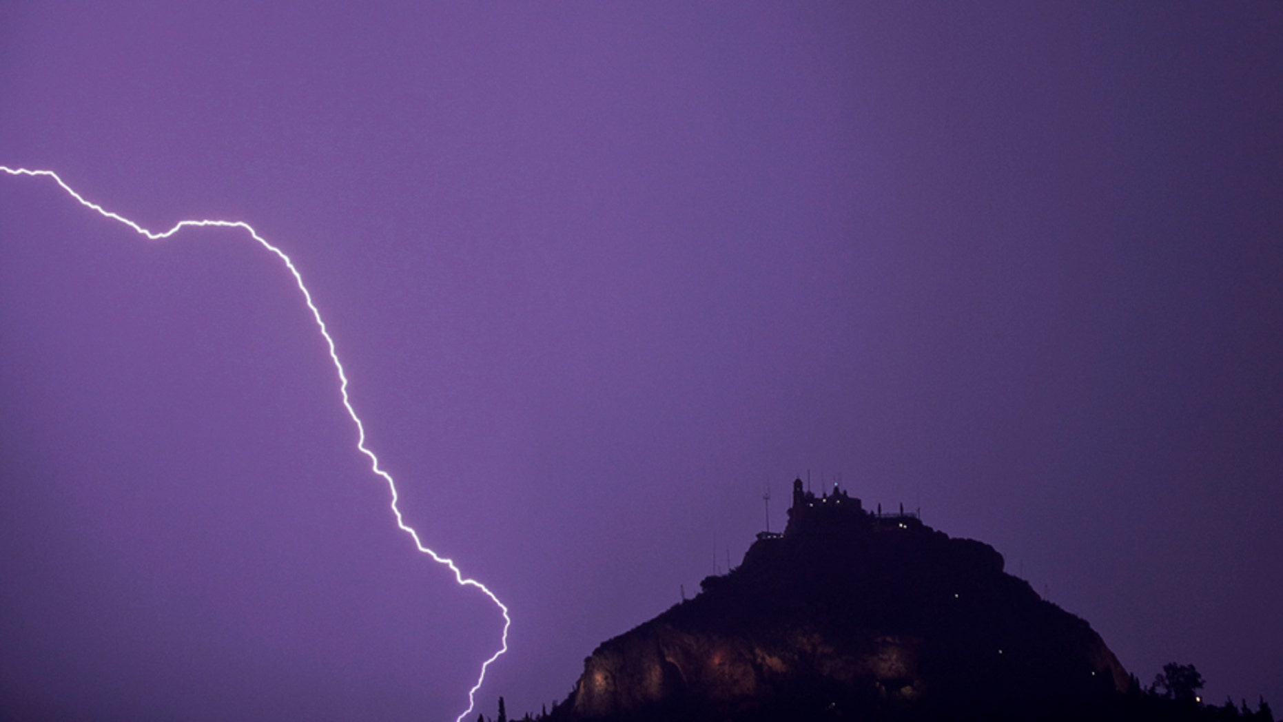 File photo - Lightning strikes over Lycabettus hill in Athens, October 24, 2014.