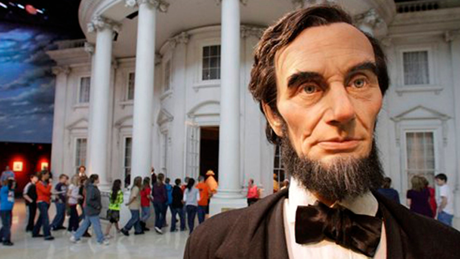 """Feb. 10, 2012: School students enter the """"White House"""" as a life size Abraham Lincoln replica stands outside, while touring the Abraham Lincoln Presidential Library and Museum with classmates in Springfield, Ill."""