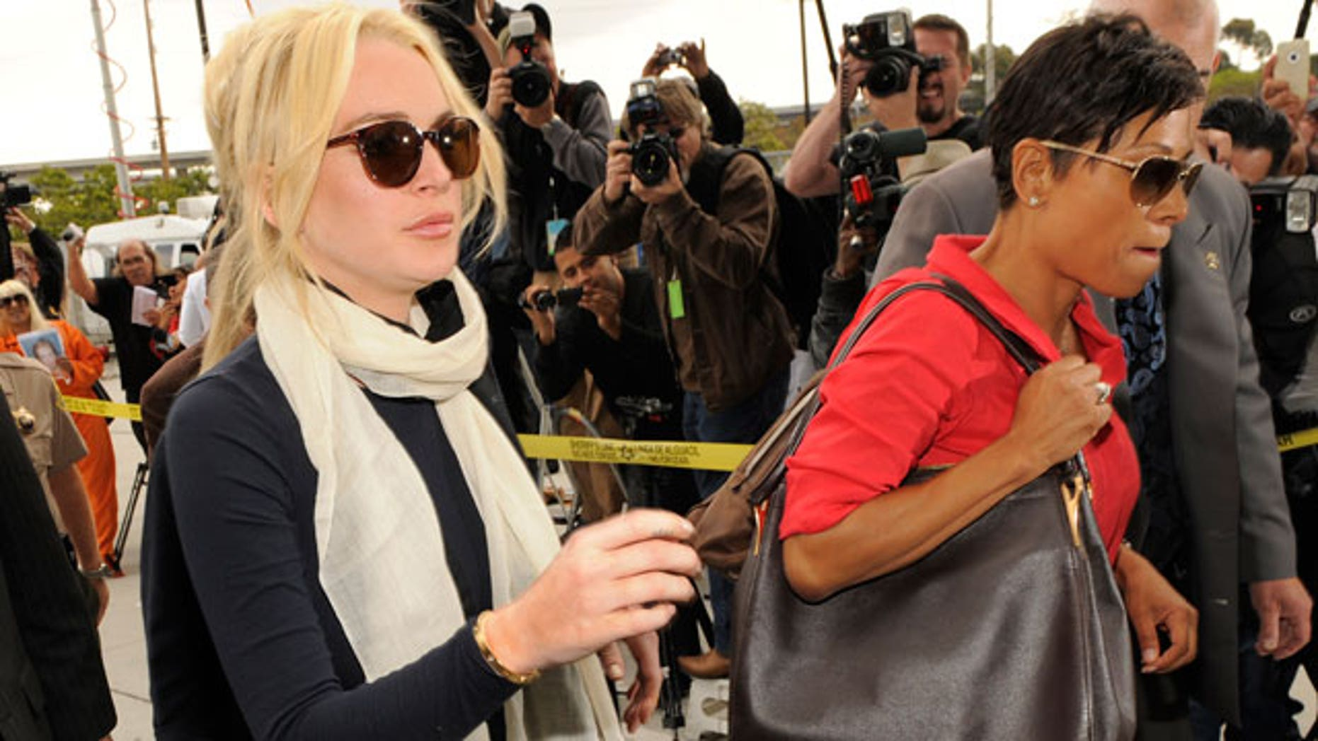 April 22: Lindsay Lohan and her lawyer Shawn Chapman Holley arrive for a hearing on Lohan's jewelry theft case in Los Angeles(AP).