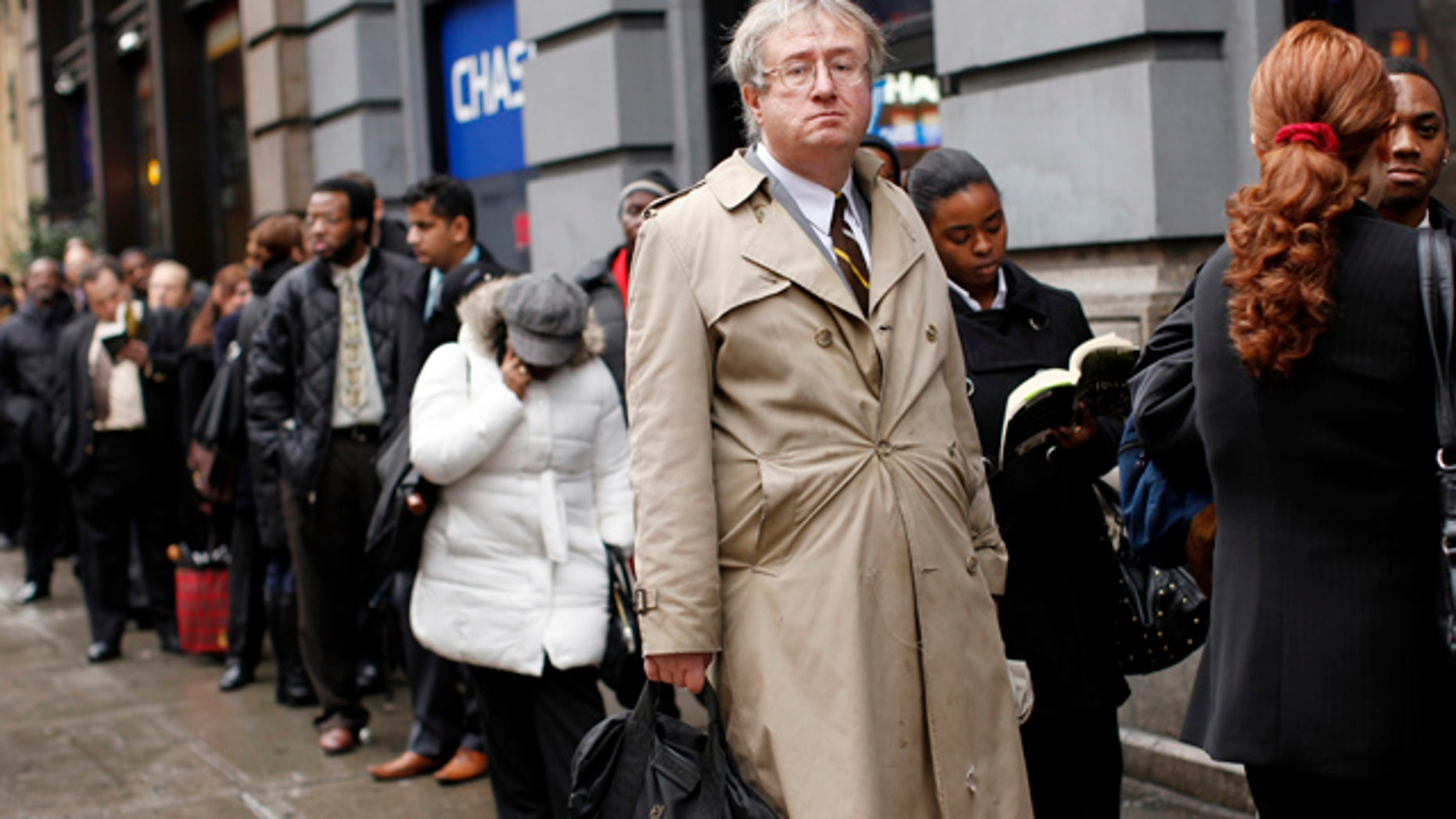 FILE: Eric Lipps, 52, waits in line to enter the NYCHires Job Fair on Dec. 9, 2009, in New York City.