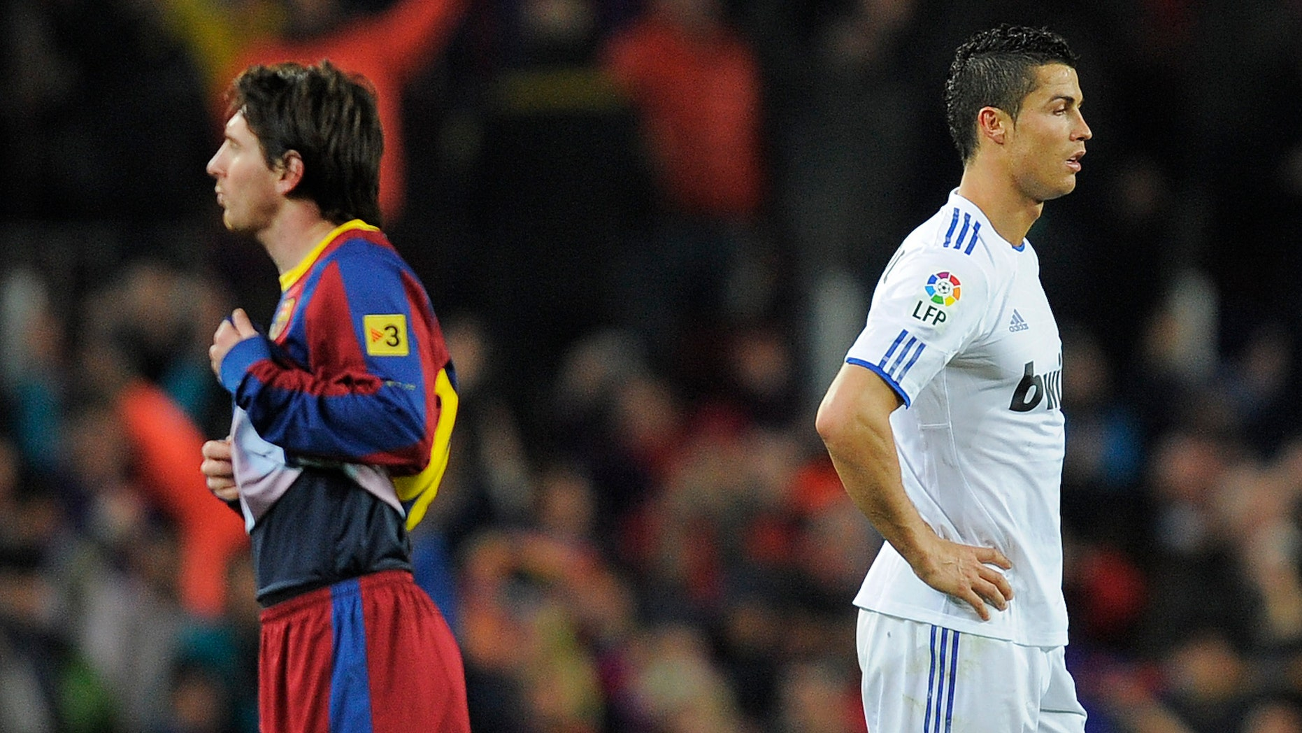 BARCELONA, SPAIN - NOVEMBER 29:  Cristiano Ronaldo of Real Madrid (R) and Lionel Messi of FC Barcelona look on during the La Liga match between Barcelona and Real Madrid at the Camp Nou Stadium on November 29, 2010 in Barcelona, Spain.  Barcelona won the match 5-0.  (Photo by David Ramos/Getty Images)