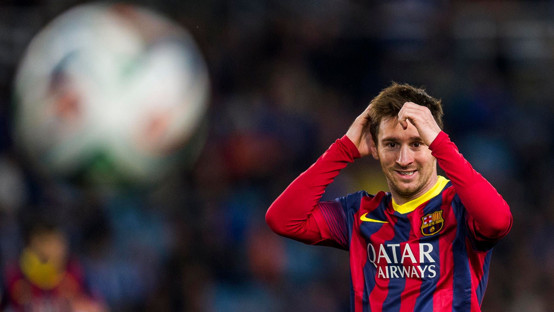 SAN SEBASTIAN, SPAIN - FEBRUARY 12:  Lionel Messi of FC Barcelona reacts during the Copa del Rey Semi-Final first leg match betweenReal Sociedad and Barcelona at Estadio Anoeta  on February 12, 2014 in San Sebastian, Spain.  (Photo by Juan Manuel Serrano Arce/Getty Images)