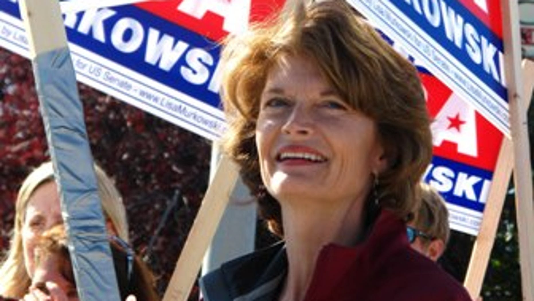 """U.S. Sen. Lisa Murkowski, R-Alaska, right, joins volunteers to wave to motorists on Monday, Aug. 23, 2010, in Anchorage, Alaska.  Candidates are pulling no punches in their last minute push for voters in Tuesday's primary. The greatest proof of this is in the U.S. Senate race where Sarah Palin has re emerged months after first endorsing GOP challenger Joe Miller to urge Alaskans to support him and to oust Murkowski. Murkowski's not shying away, running a new radio spot of her own, called """"Truth,"""" in which she uses audio from a talk show host's tirade against Miller to show Miller as distorting her record. (AP Photo/Mark Thiessen)"""