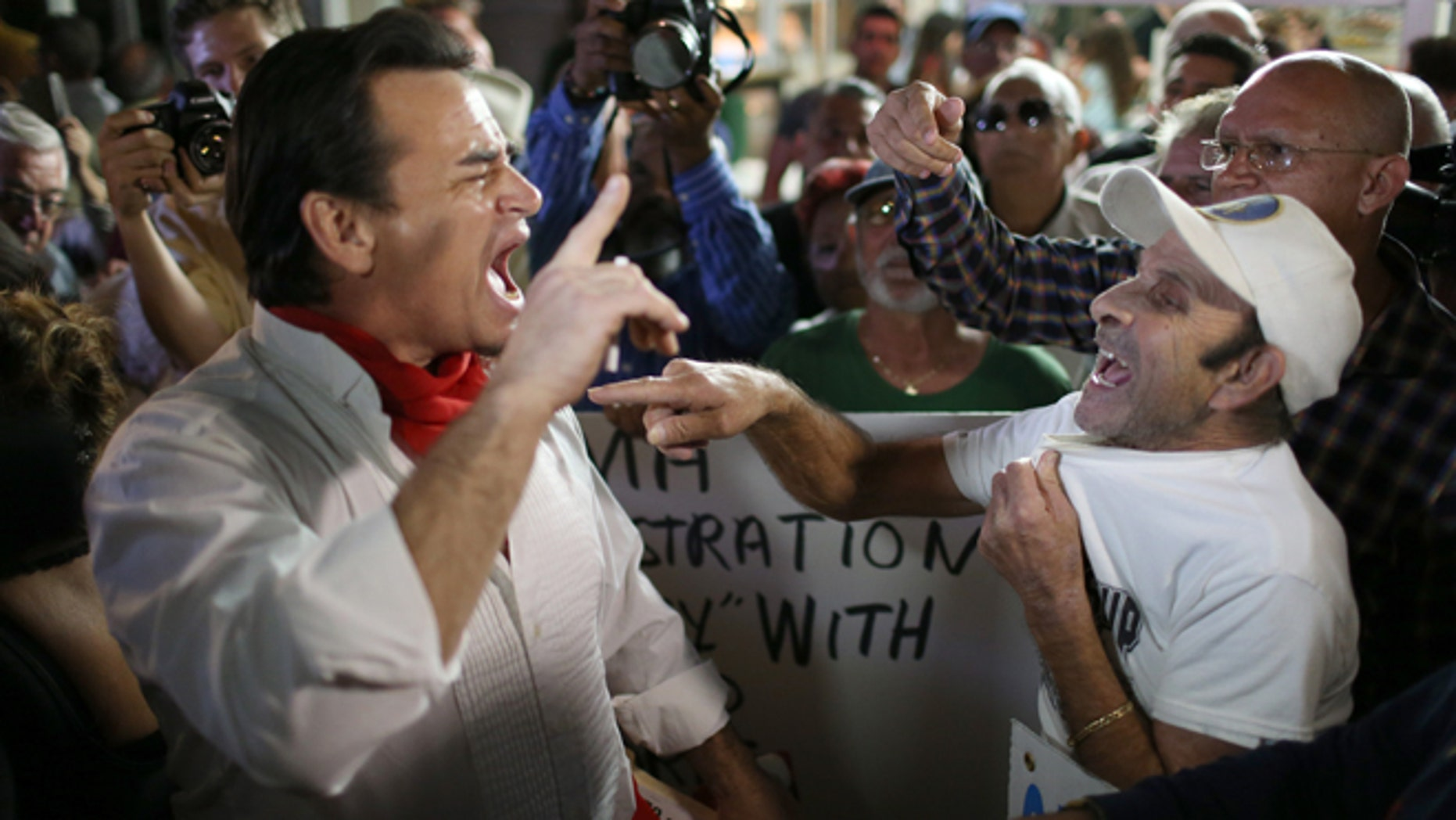 Argument over the normalization of relations between the U.S. and Cuba outside the Little Havana restaurant Versailles on December 17, 2014 in Miami, Florida. (Photo by Joe Raedle/Getty Images)