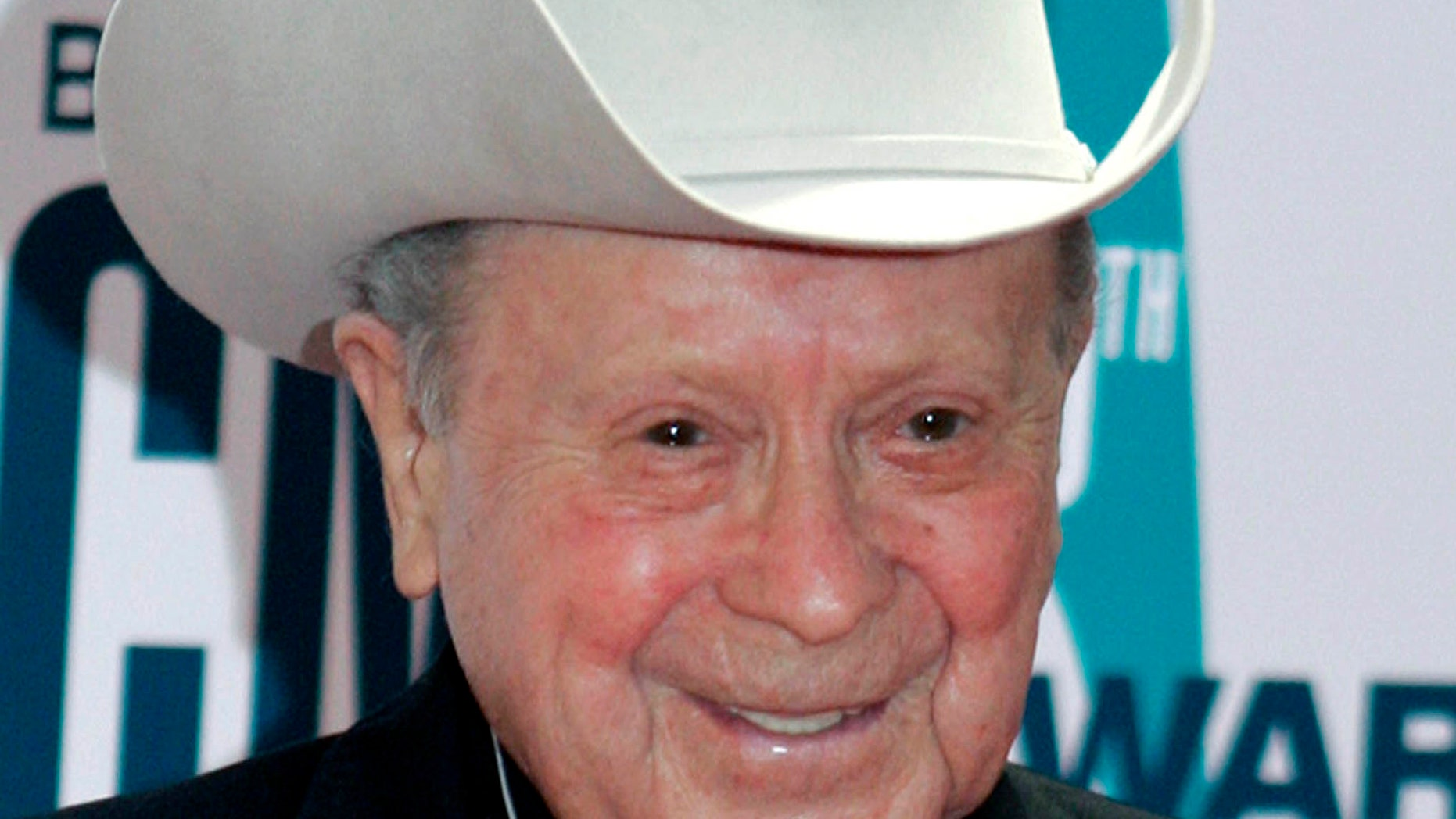 "FILE - In this Nov. 6, 2006 file photo, Grand Ole Opry star Little Jimmy Dickens arrives at the 40th Annual CMA Awards in Nashville, Tenn. Dickens has been hospitalized with an undisclosed illness. Jessie Schmidt, a publicist for the Opry, said in a news release Sunday, Dec. 28, 2014, that Dickens was admitted to a Nashville-area hospital on Dec. 25 and that he's in ""critical care."" (AP Photo/Chitose Suzuki, File)"